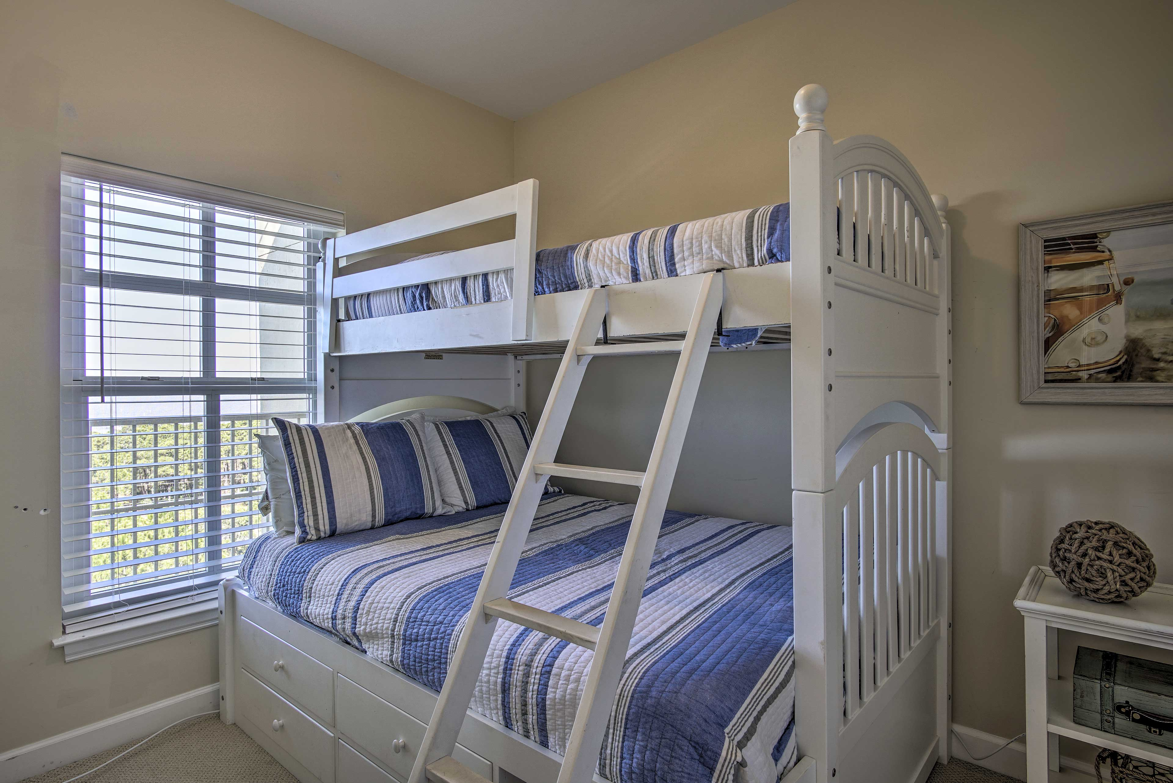 Perfect for kids, this room sleeps 3 in a twin-over-full bunk bed.