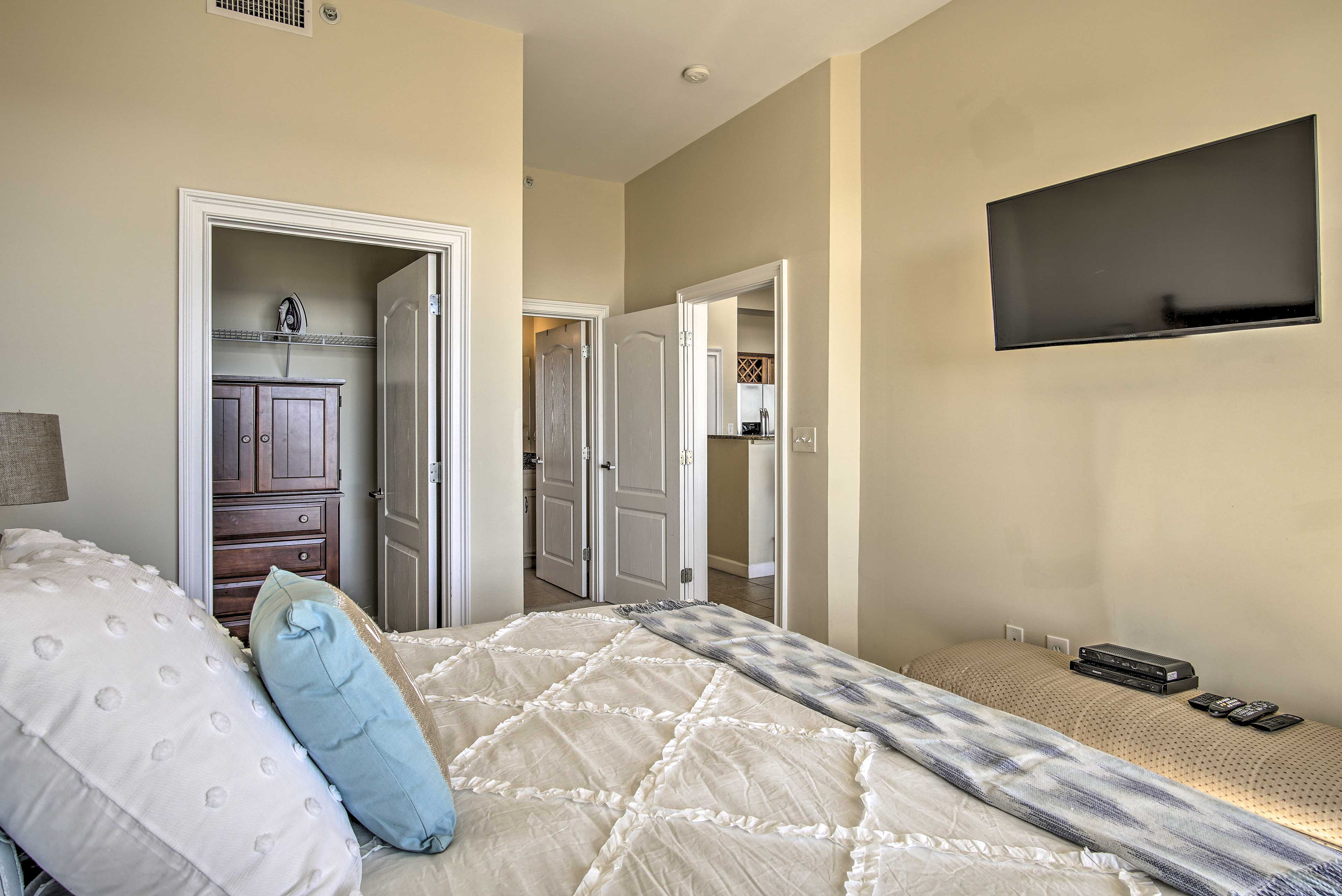 You'll be steps from the kitchen as you watch the TV from your king bed.