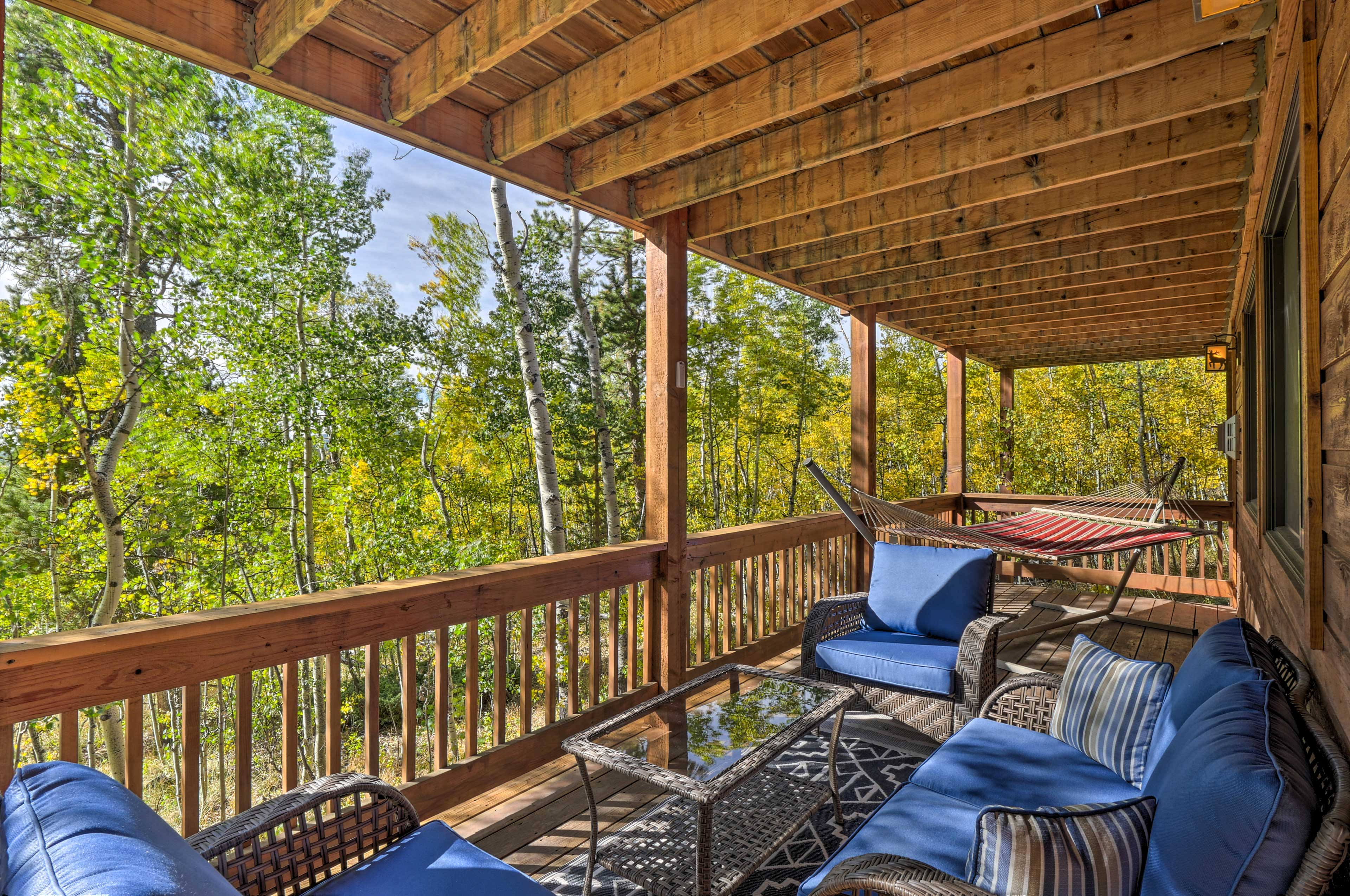 This spacious cabin-style home on 4.3 acres boasts nearly 2,600 sq feet.