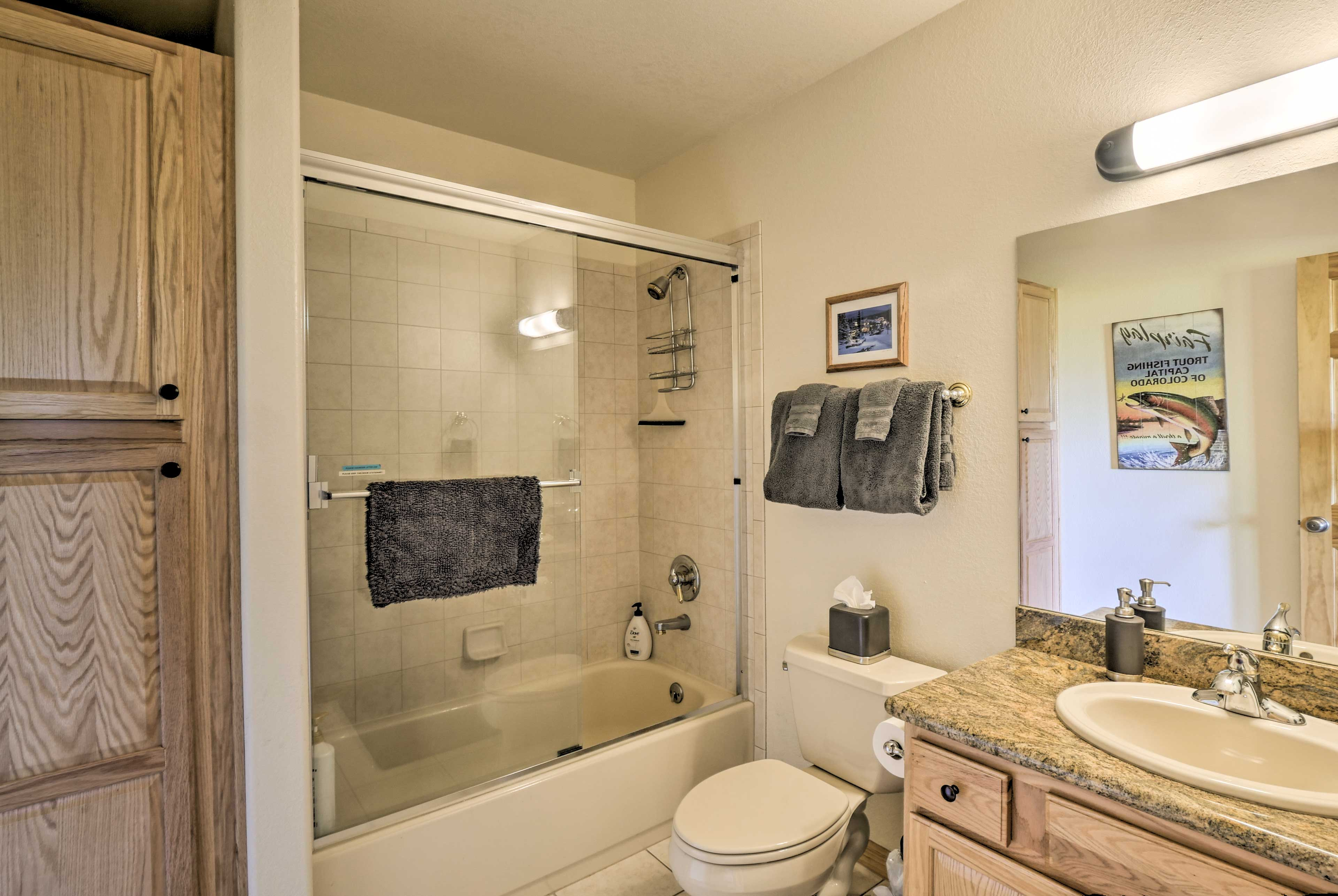 Wash up before another adventure-filled day in the shower/tub combo.