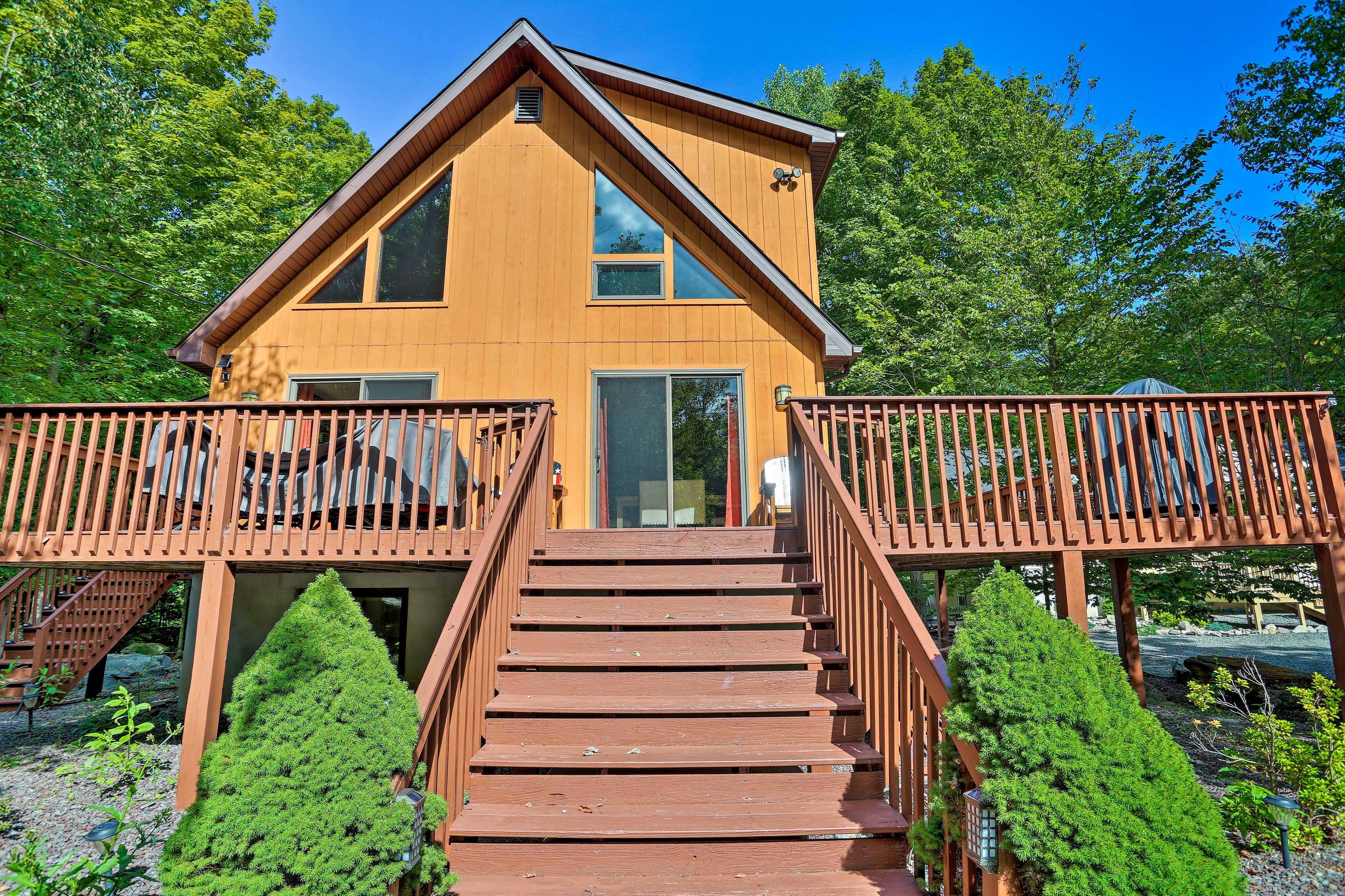 Step down the deck to the spacious yard.