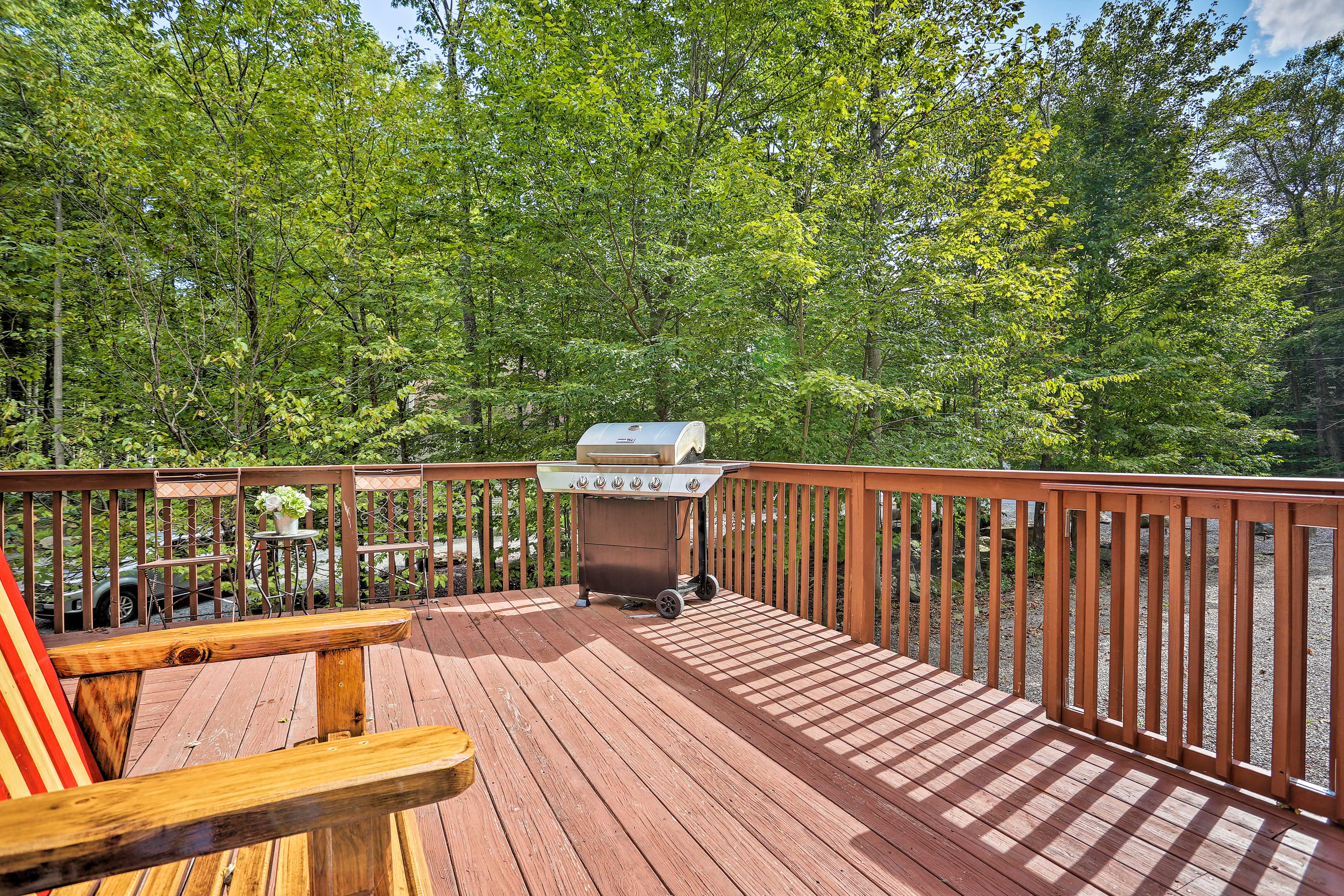 Soak in forest views from the spacious deck.