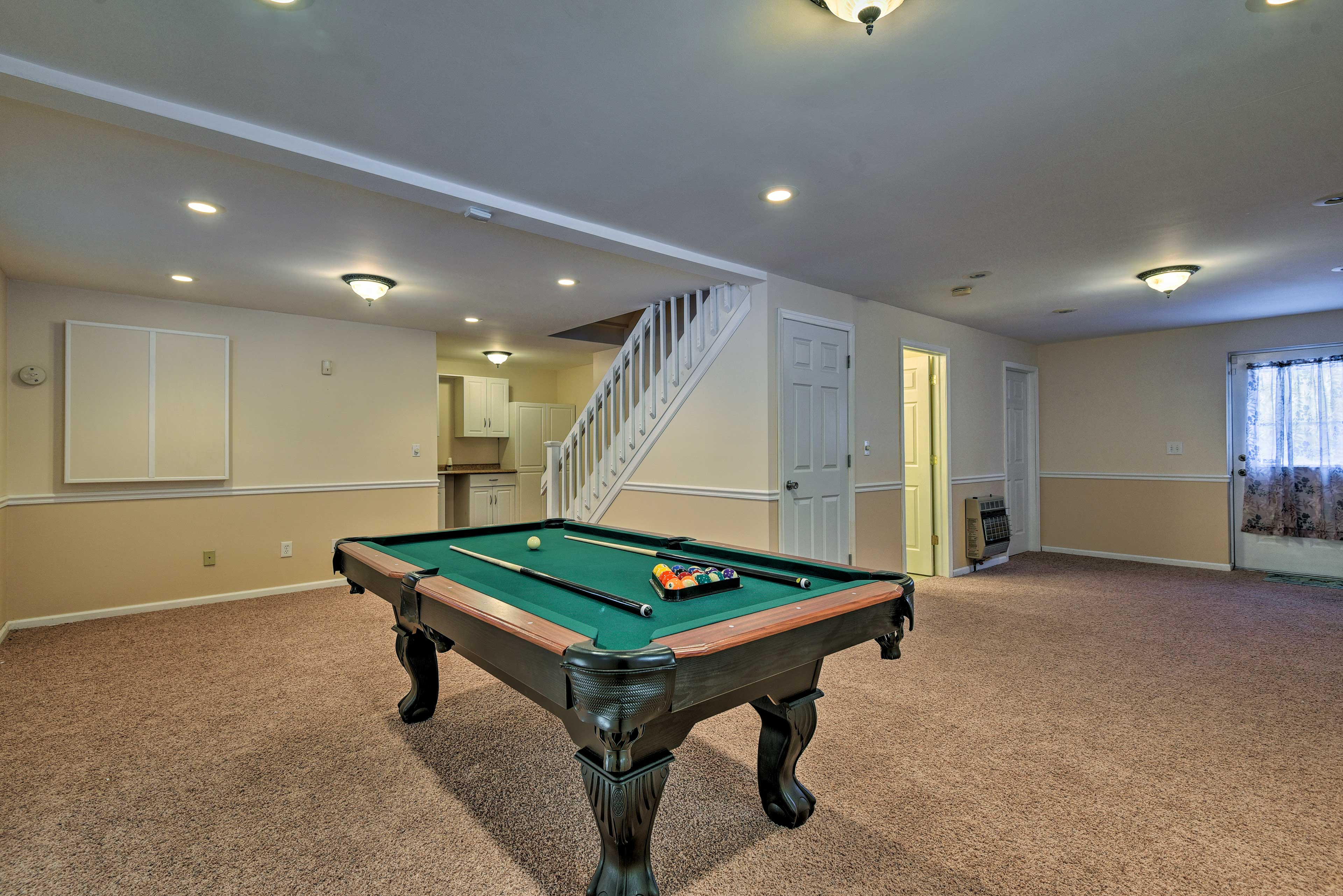 Play a game of pool at the table downstairs.