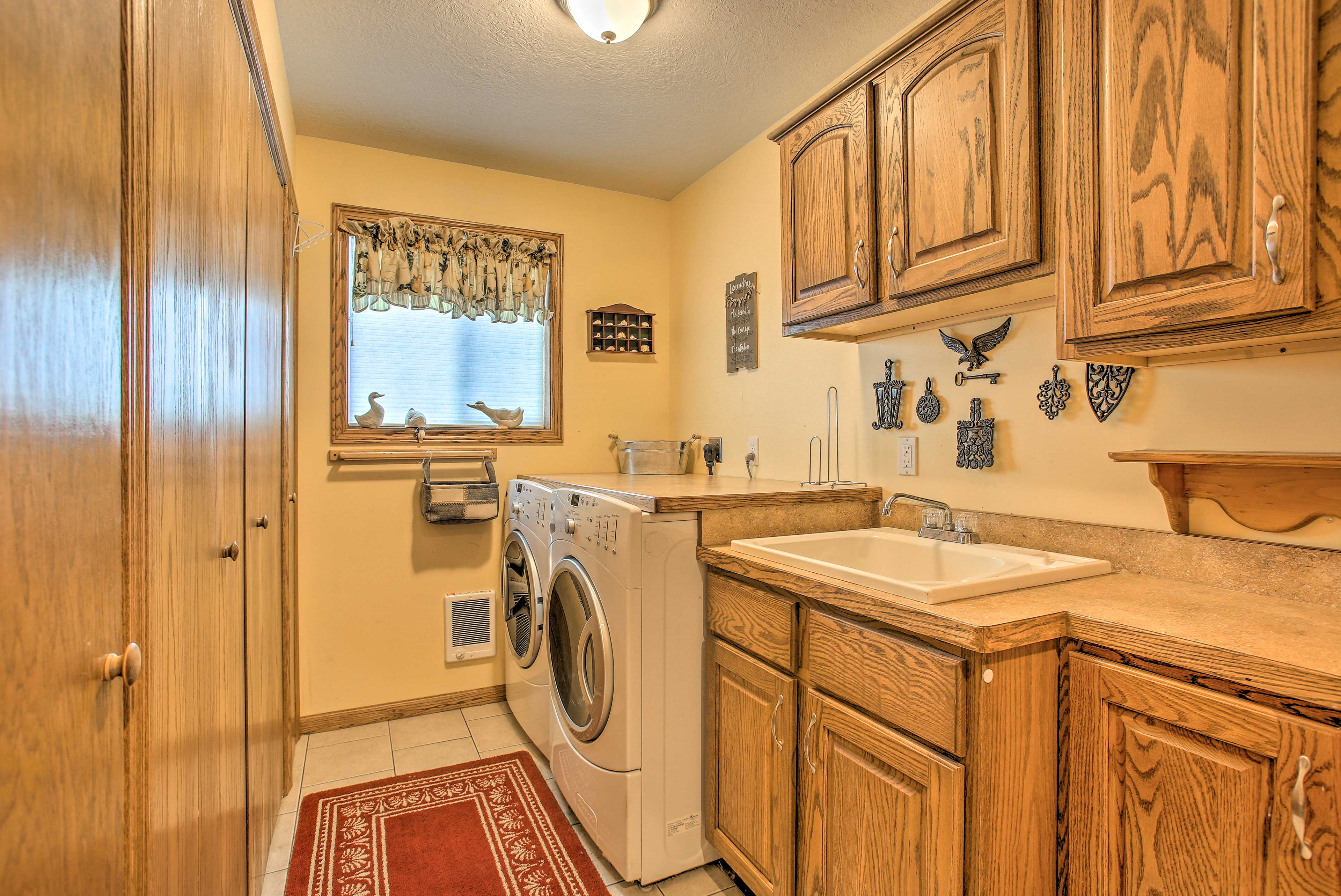 The second washer and dryer can be found downstairs with a sink as well.