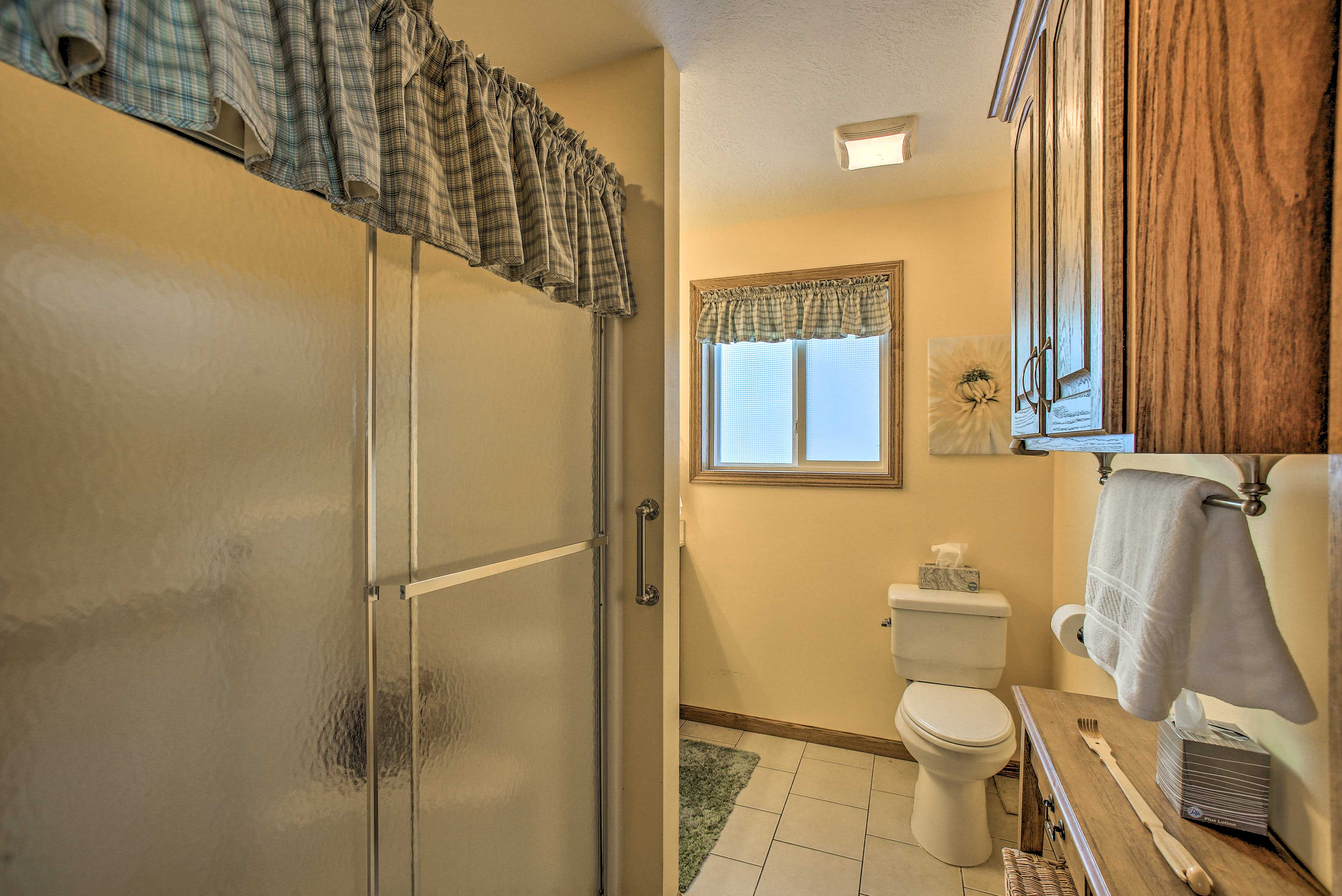 The first bathroom features a full size shower.