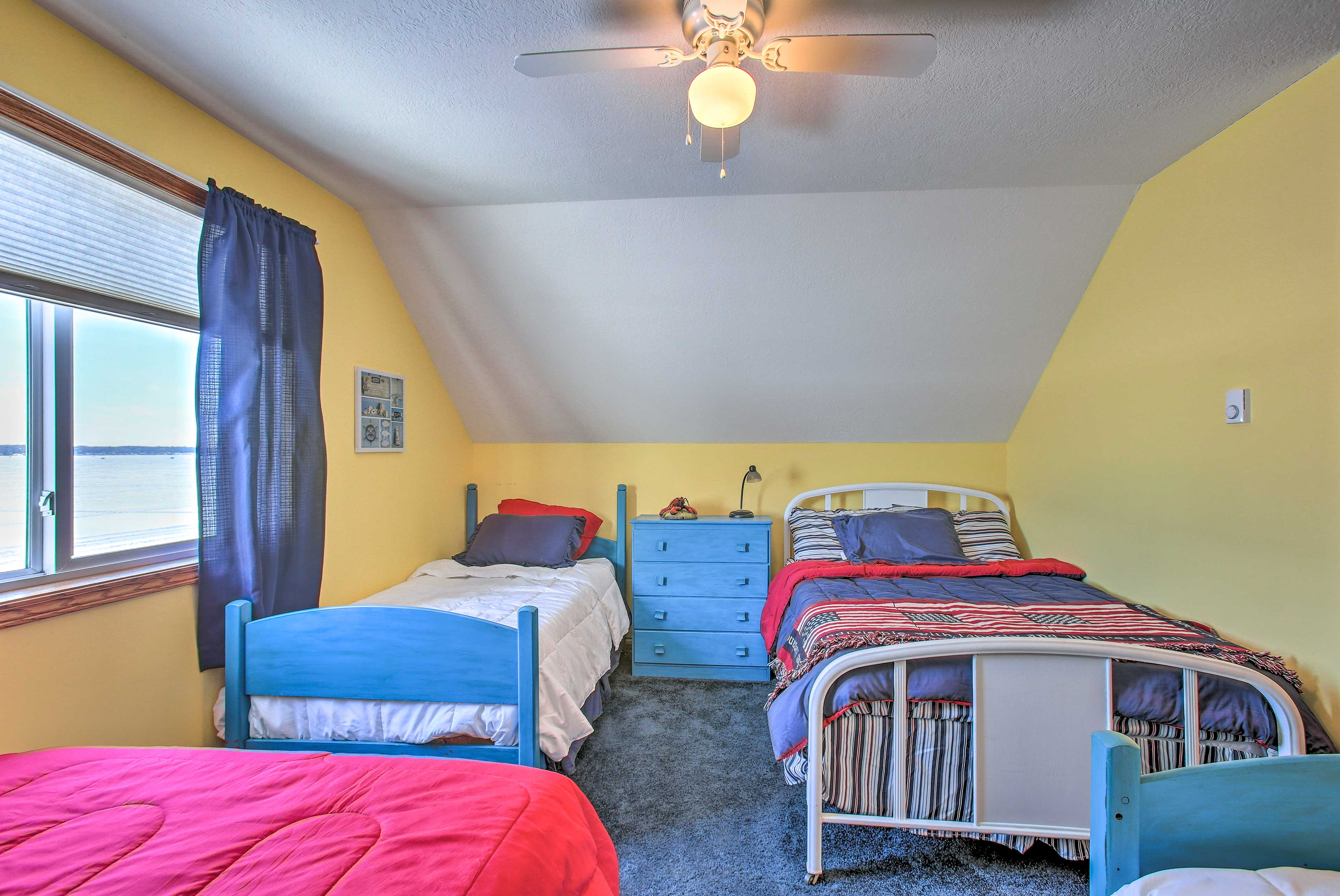 This bedroom features 2 twin and 2 full beds.