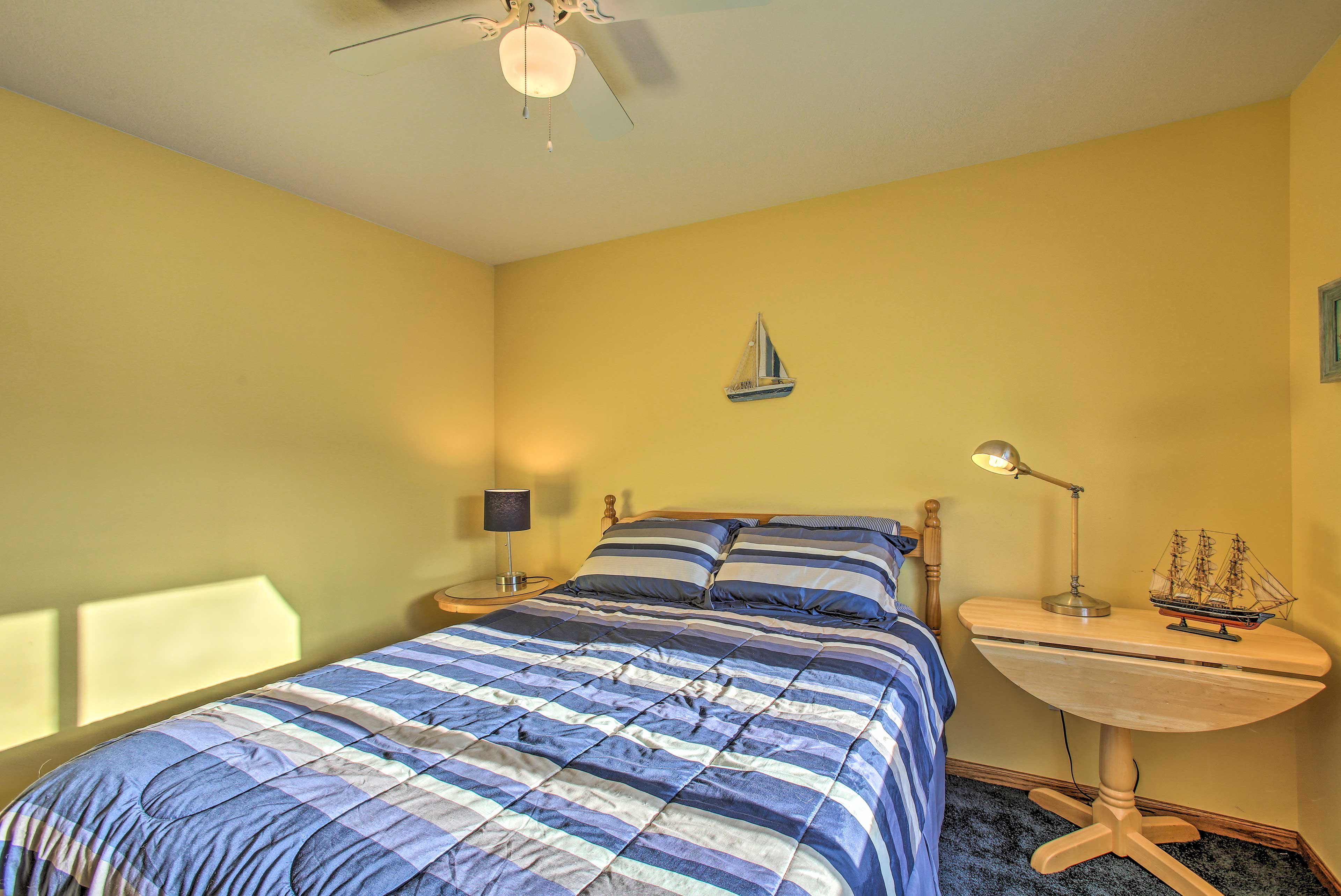 Bedroom 3 offers a queen-sized bed and nightstand/table combo.