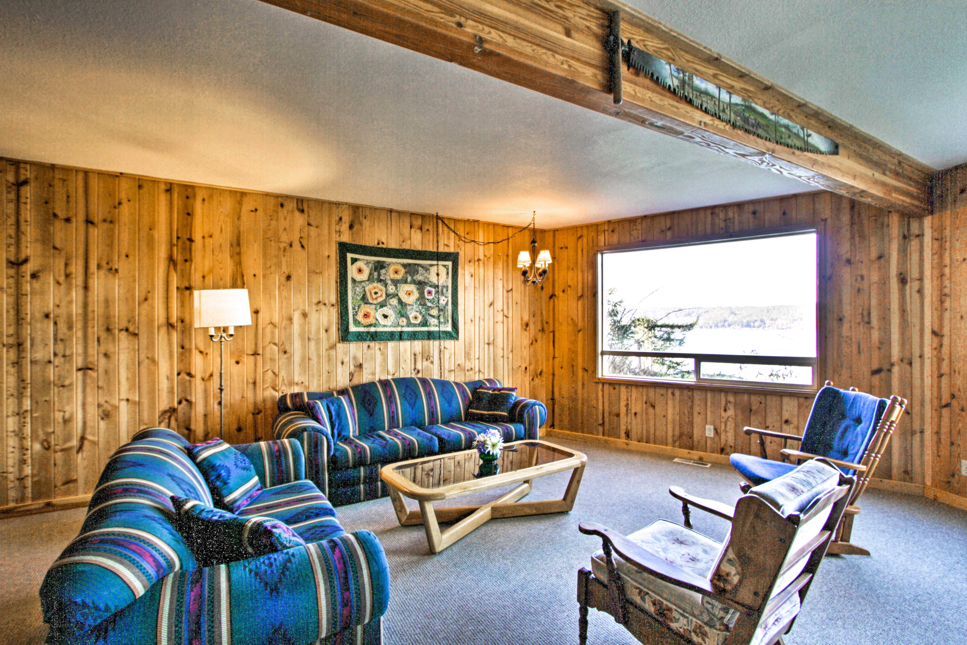 The downstairs living area features additional seating and picturesque views.