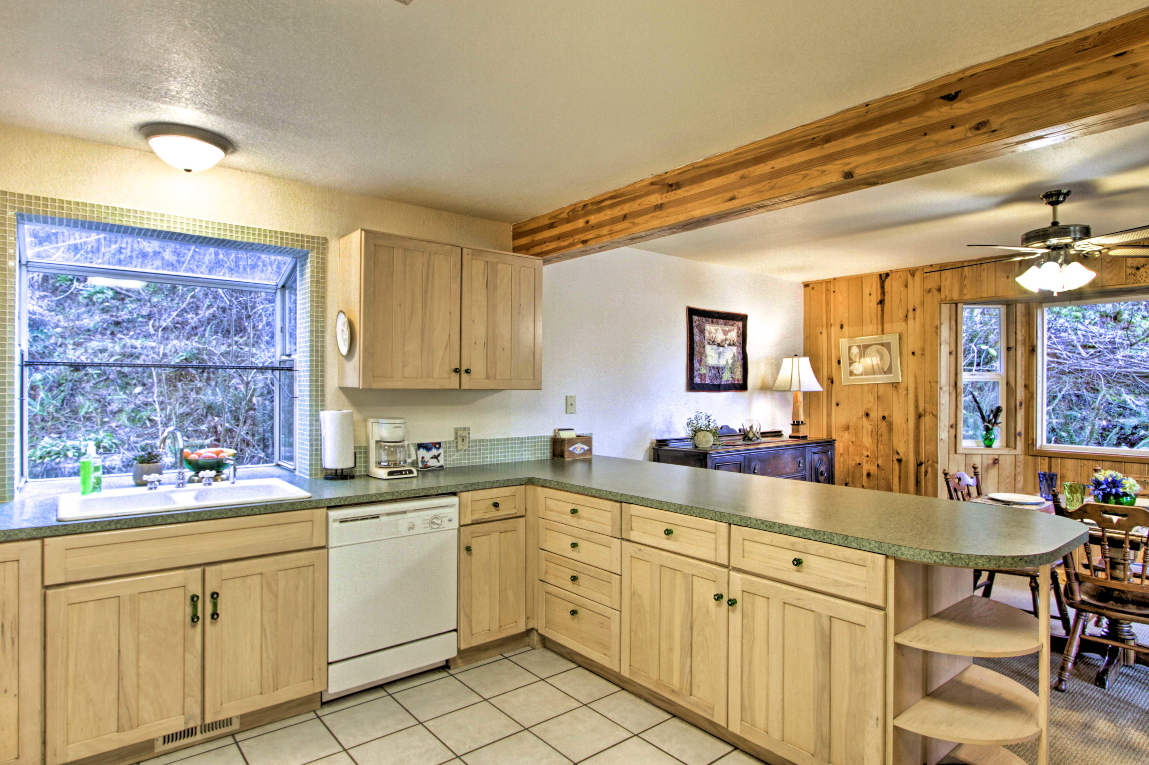 The kitchen features wraparound counters with plenty of cabinet storage.