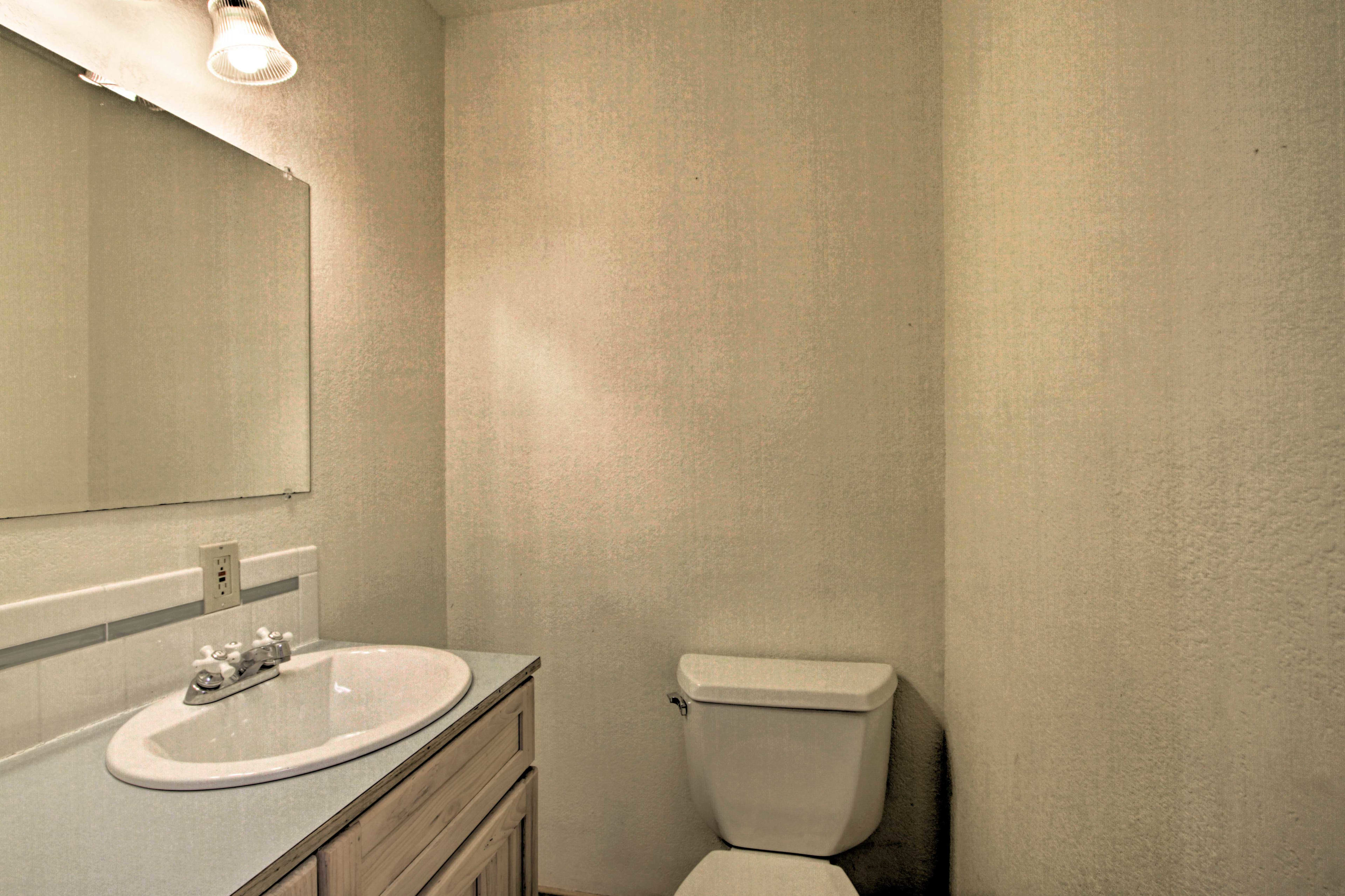 This half bathroom is set just off of the main living area.