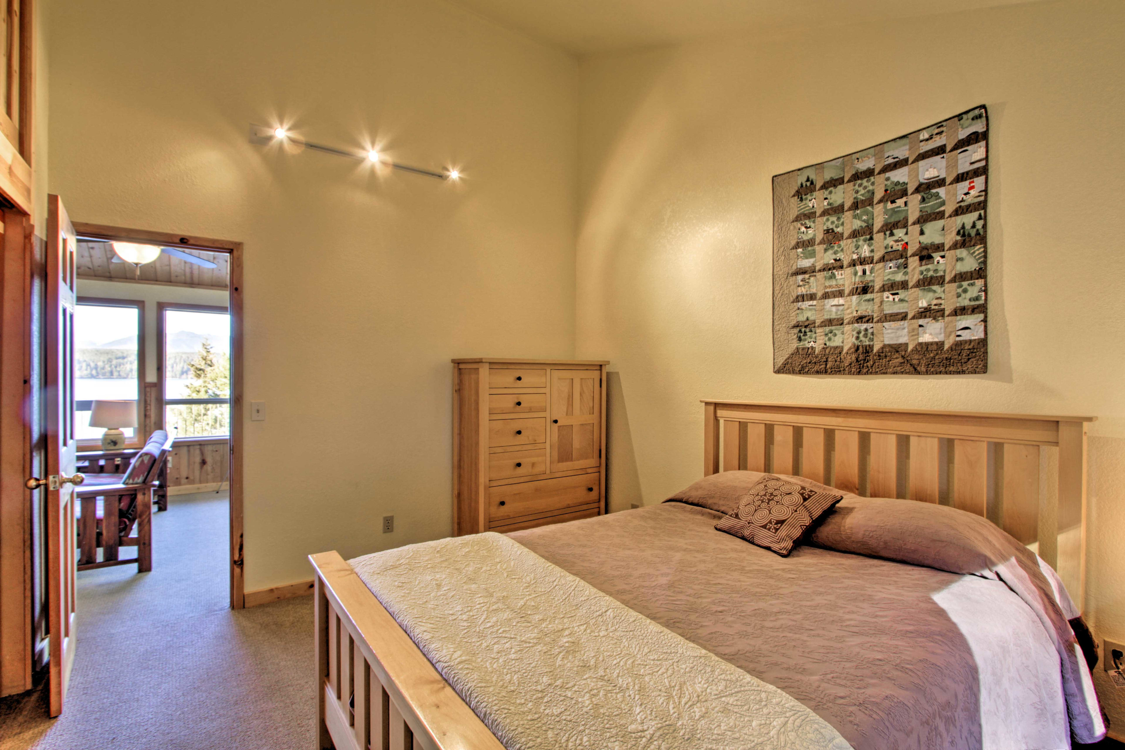 The bedroom boasts plenty of storage and a dresser.