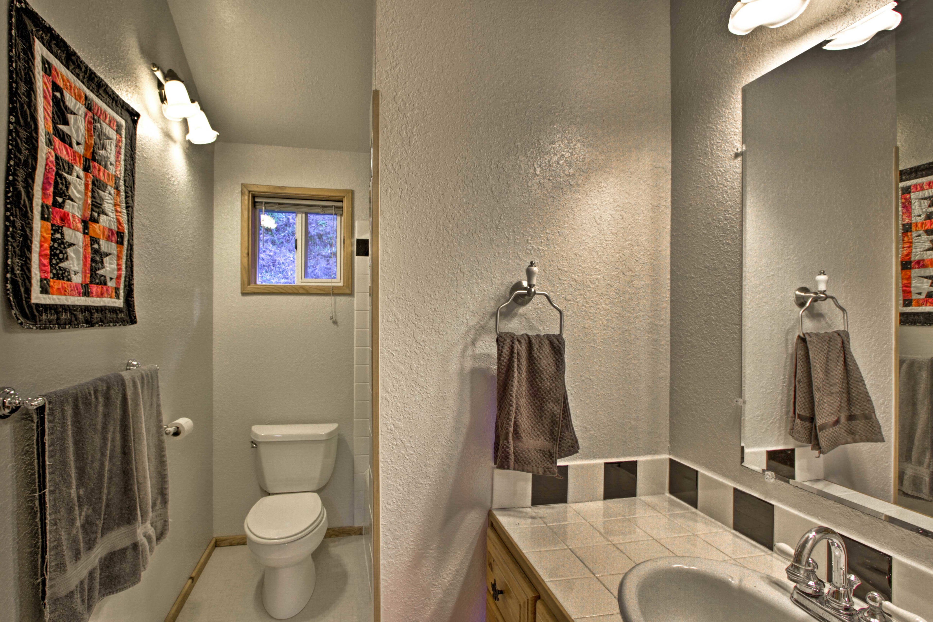 The third full bathroom is outfitted with a shower/tub combo.