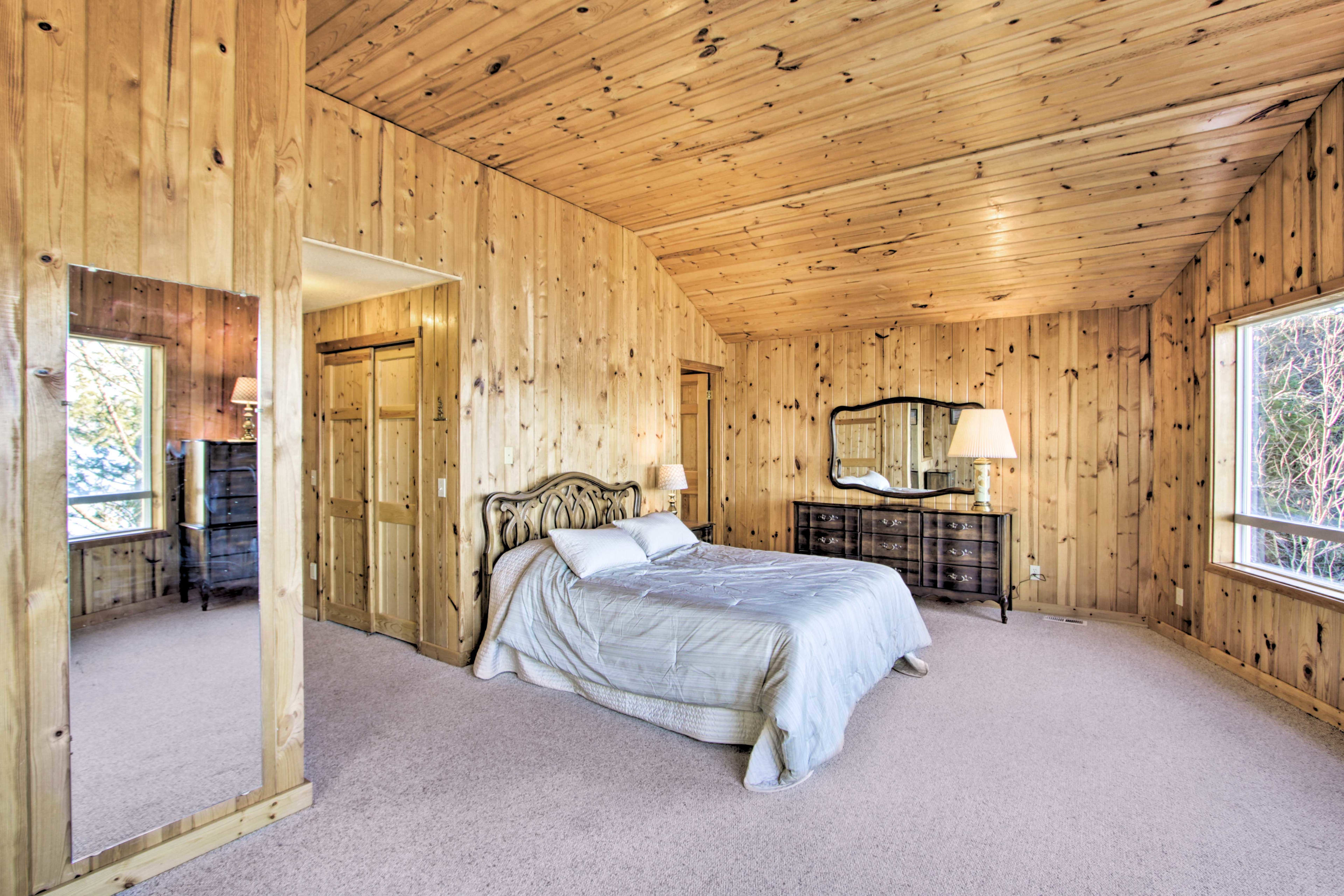 Spacious and bright, the master bedroom features a queen bed.