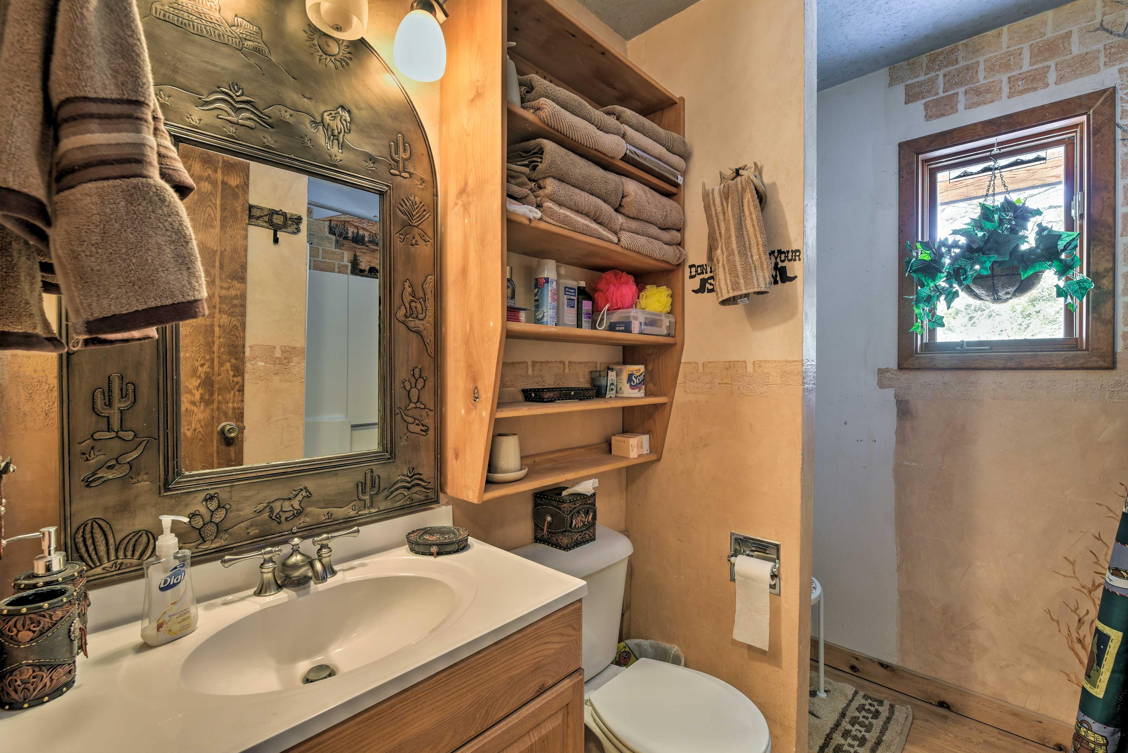 The home's full bathroom is complete with freshly laundered towels for everyone.