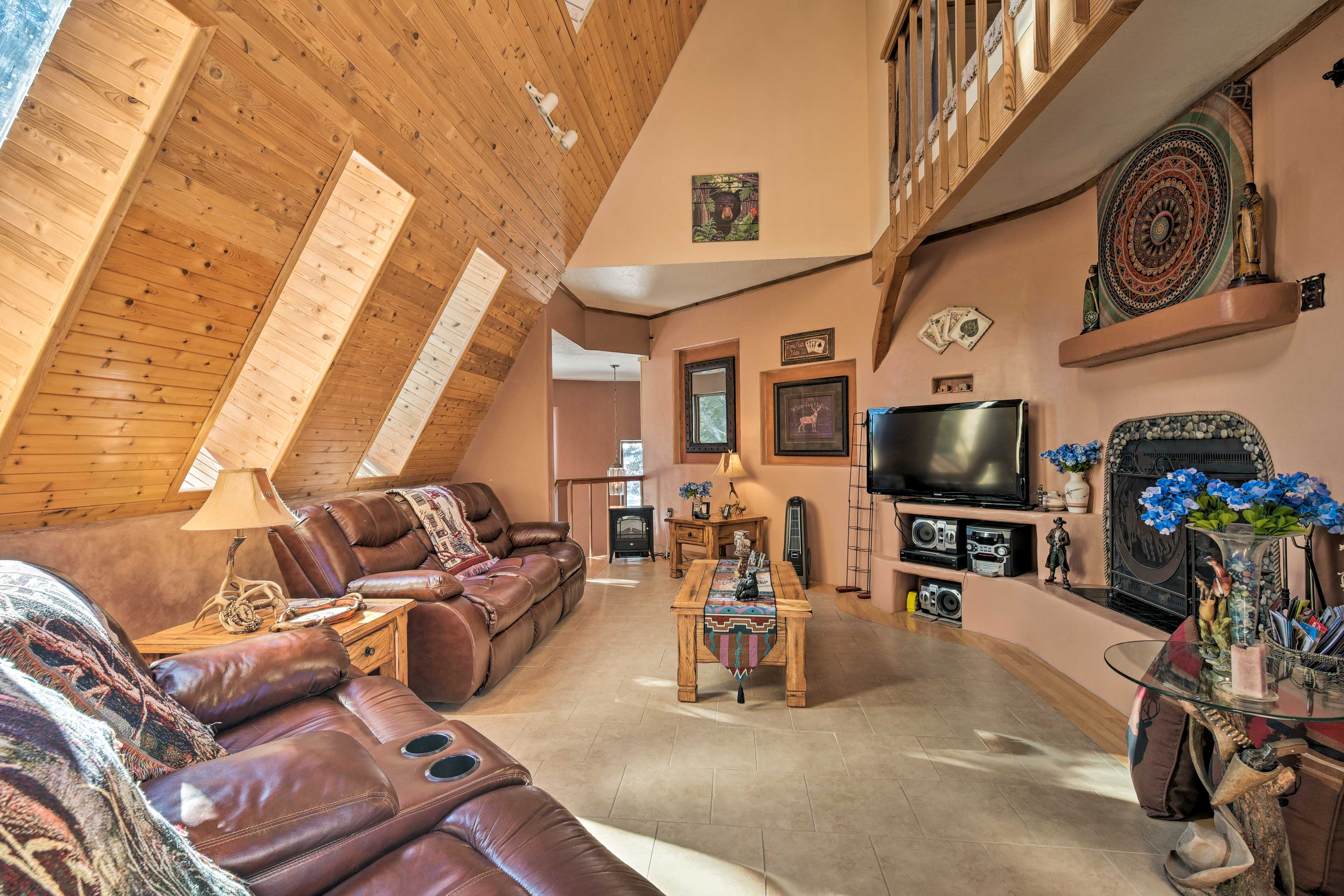 Natural light illuminates the southwestern interior with a TV and fireplace.