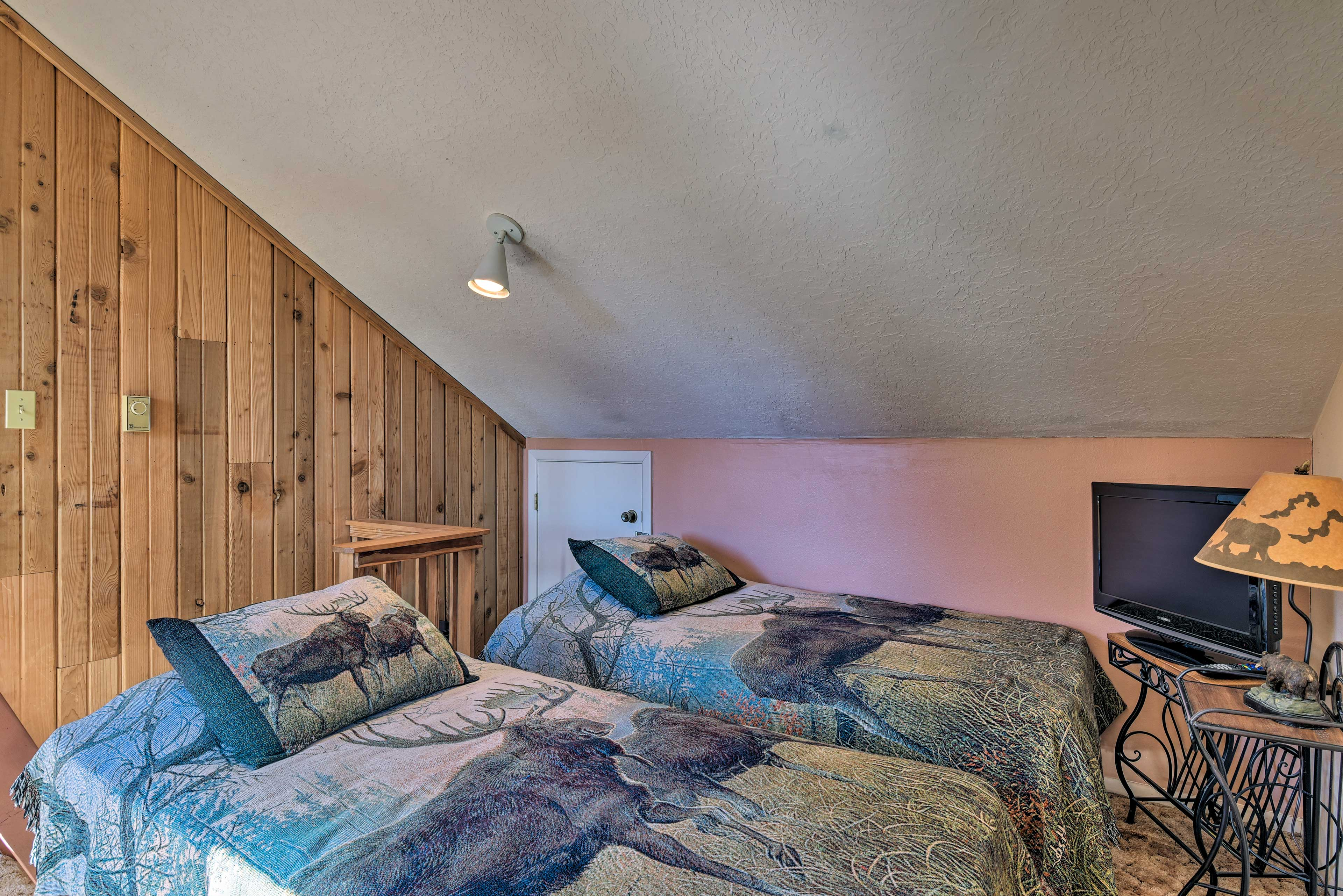 The upstairs loft features 2 twin-sized beds, great for kids and teens!
