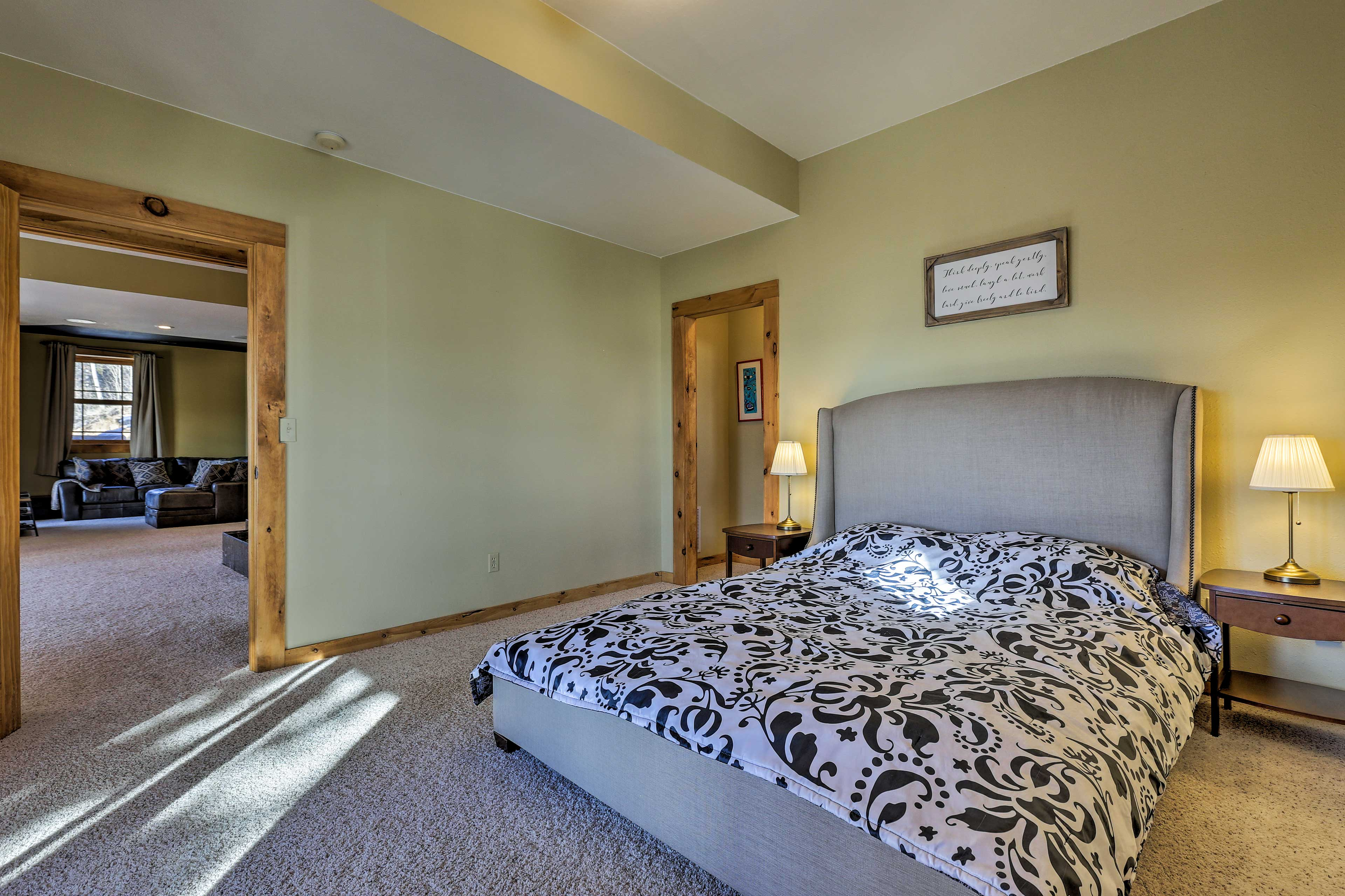 The room boasts a queen bed.