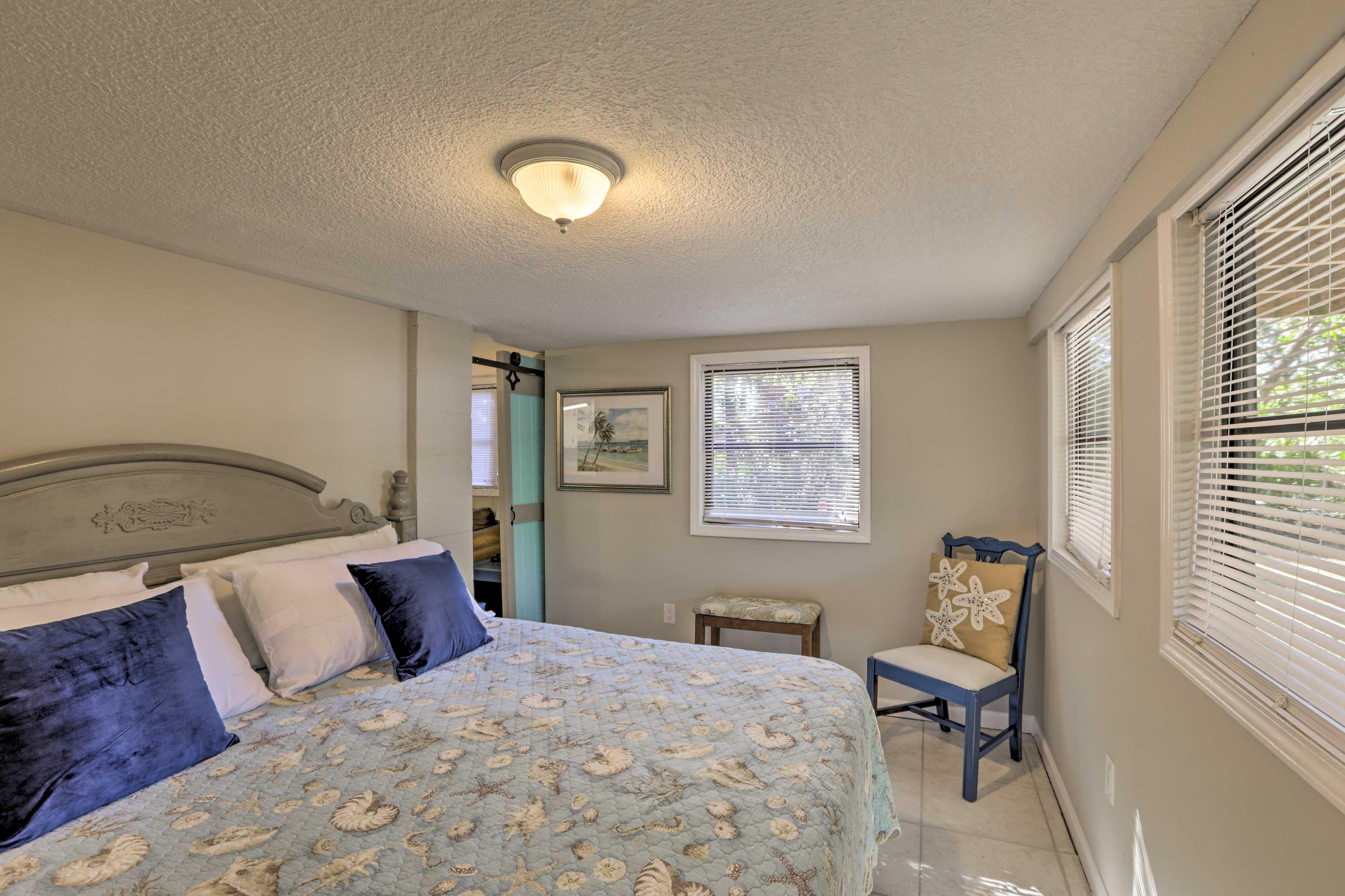 This bedroom is hidden behind a sliding barn door!