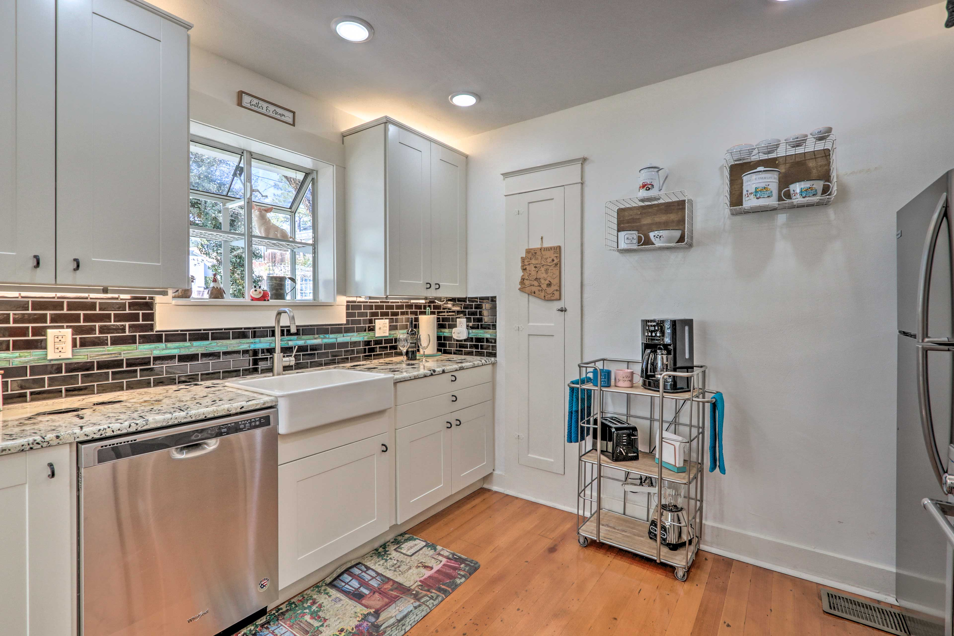 The kitchen boasts expansive countertops and stainless steel appliances.