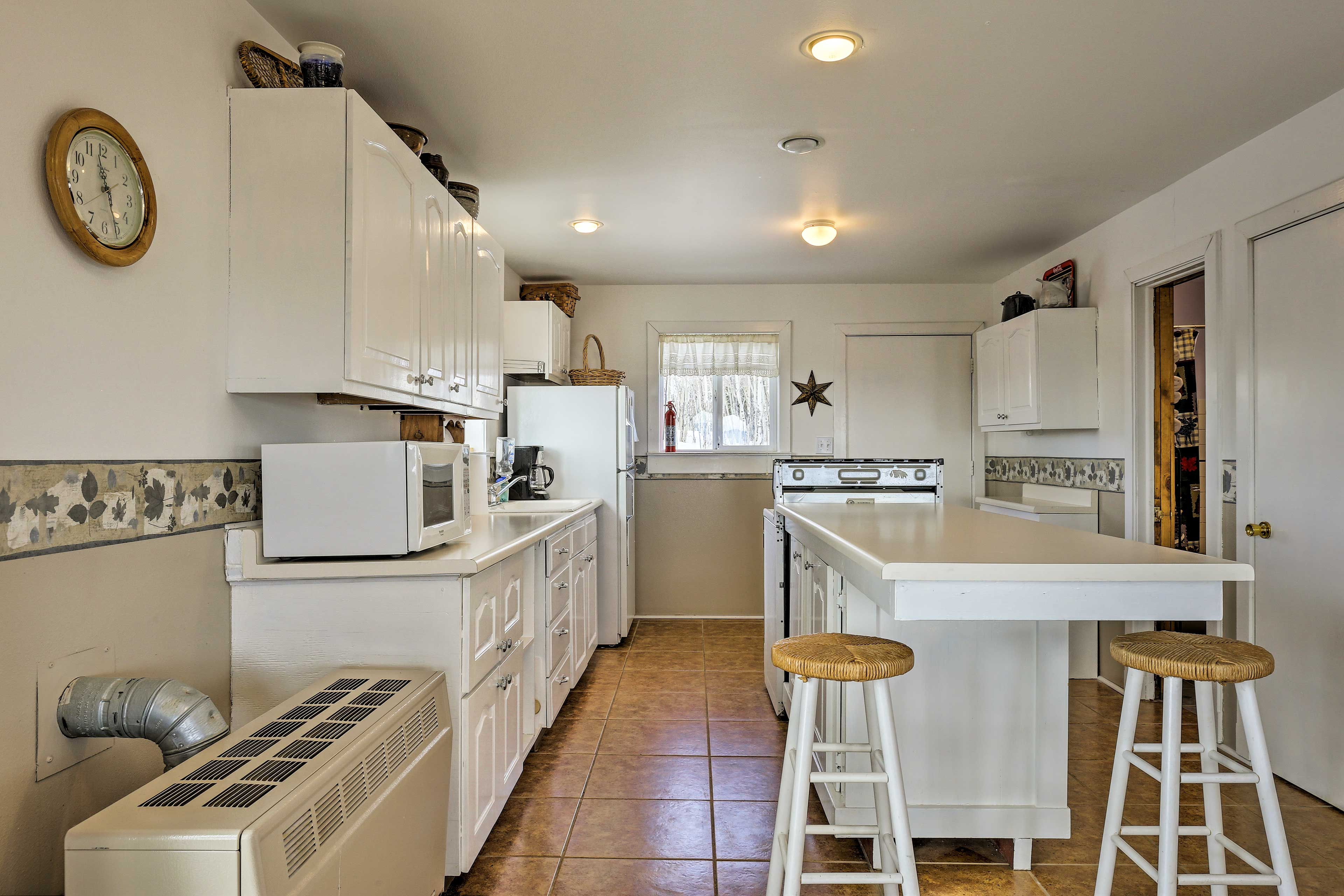 The well-equipped kitchen makes it easy to prepare home-cooked meals.