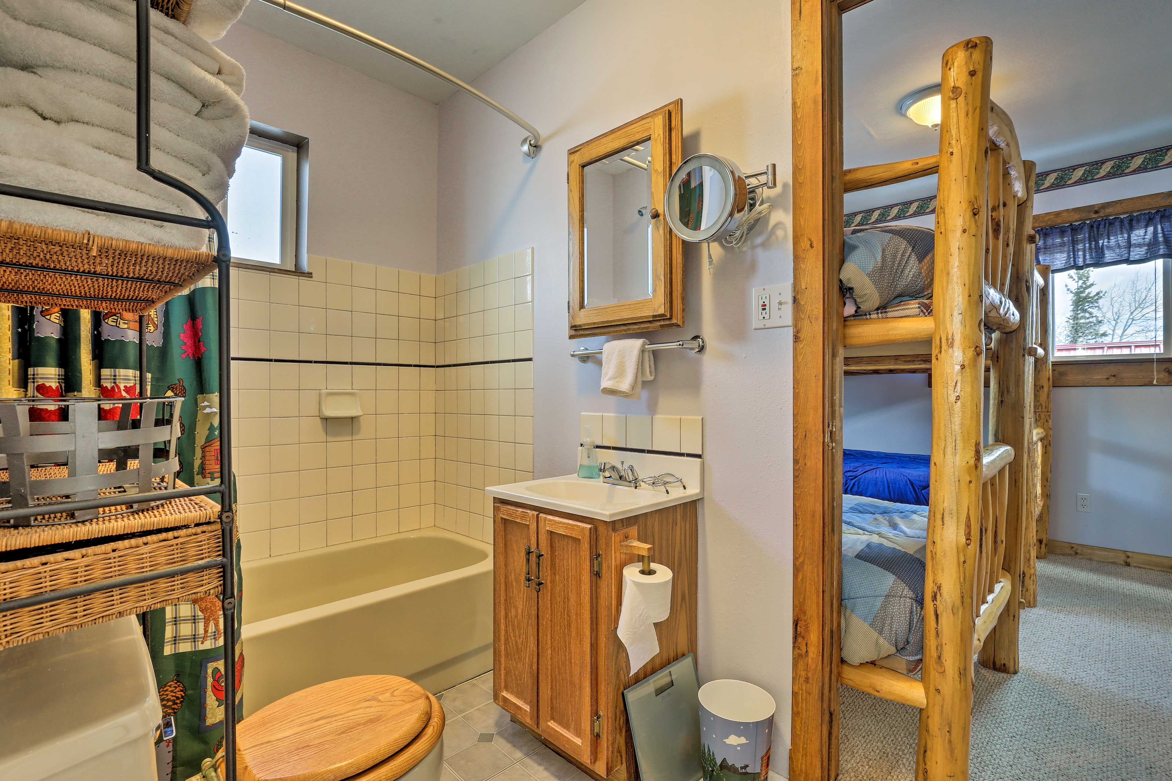 The room has an en-suite bathroom with a shower/tub combo.
