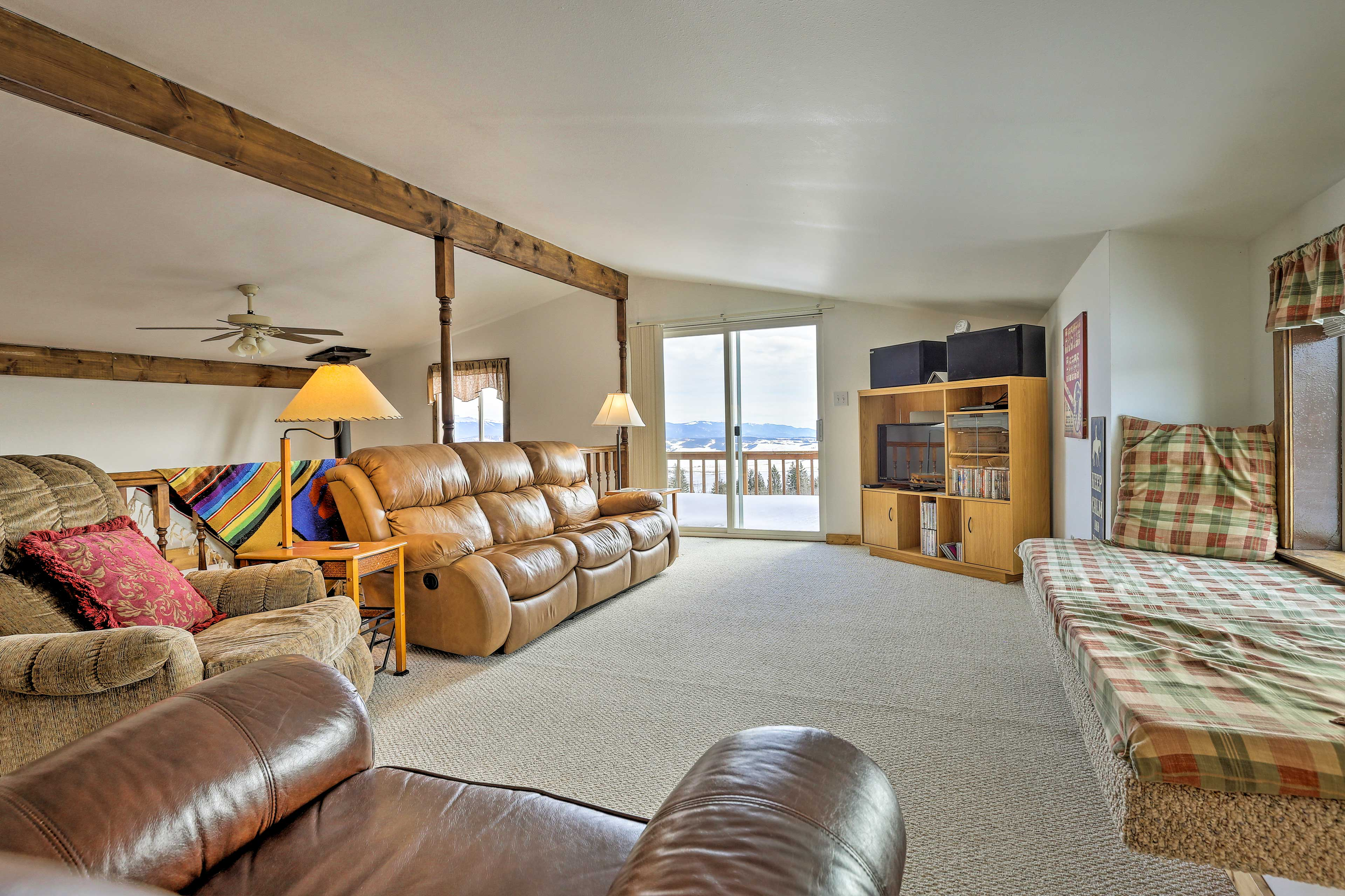 Upstairs, the living room has a flat-screen TV & plenty places to sit!