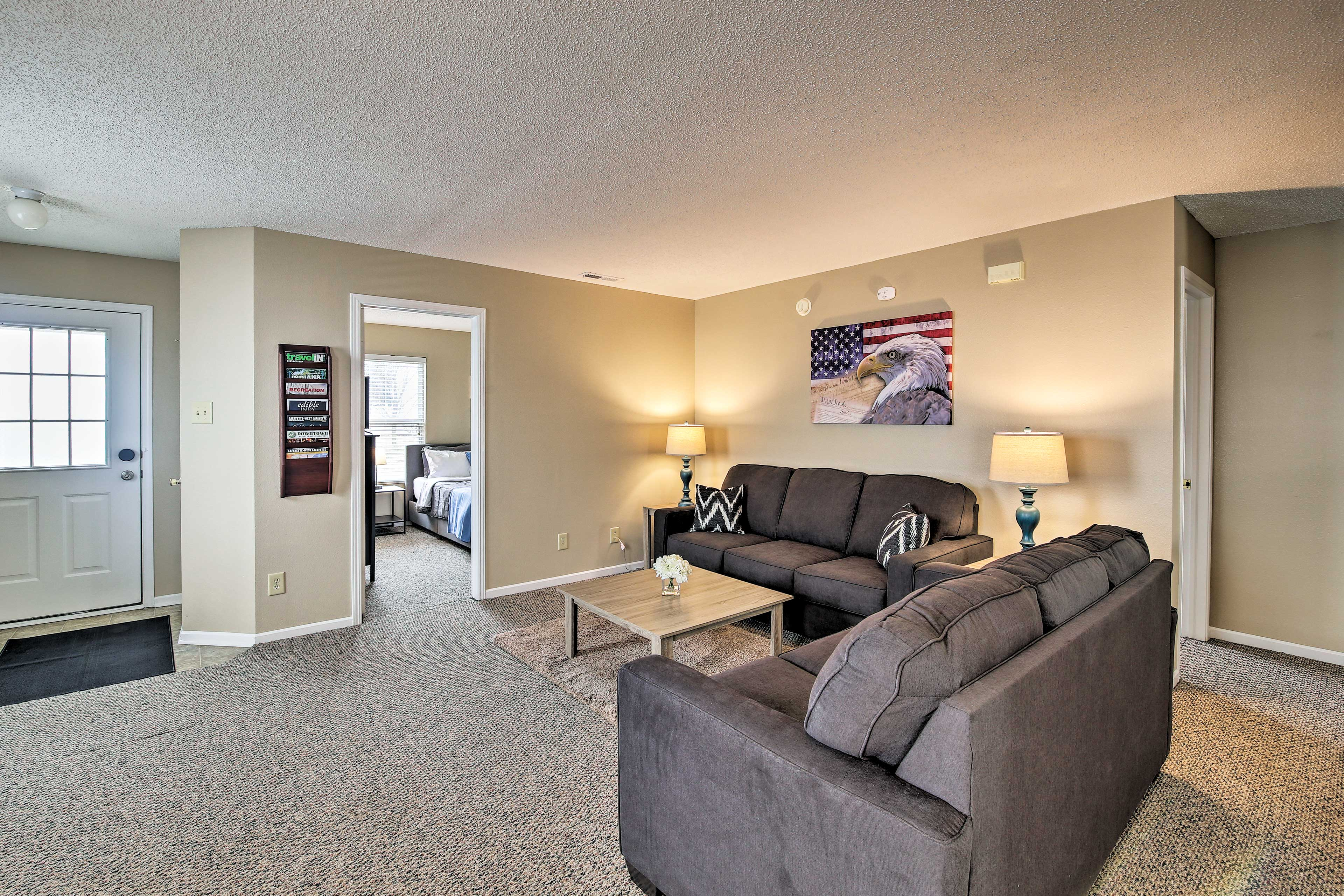 The living room features 2 sleeper sofas.