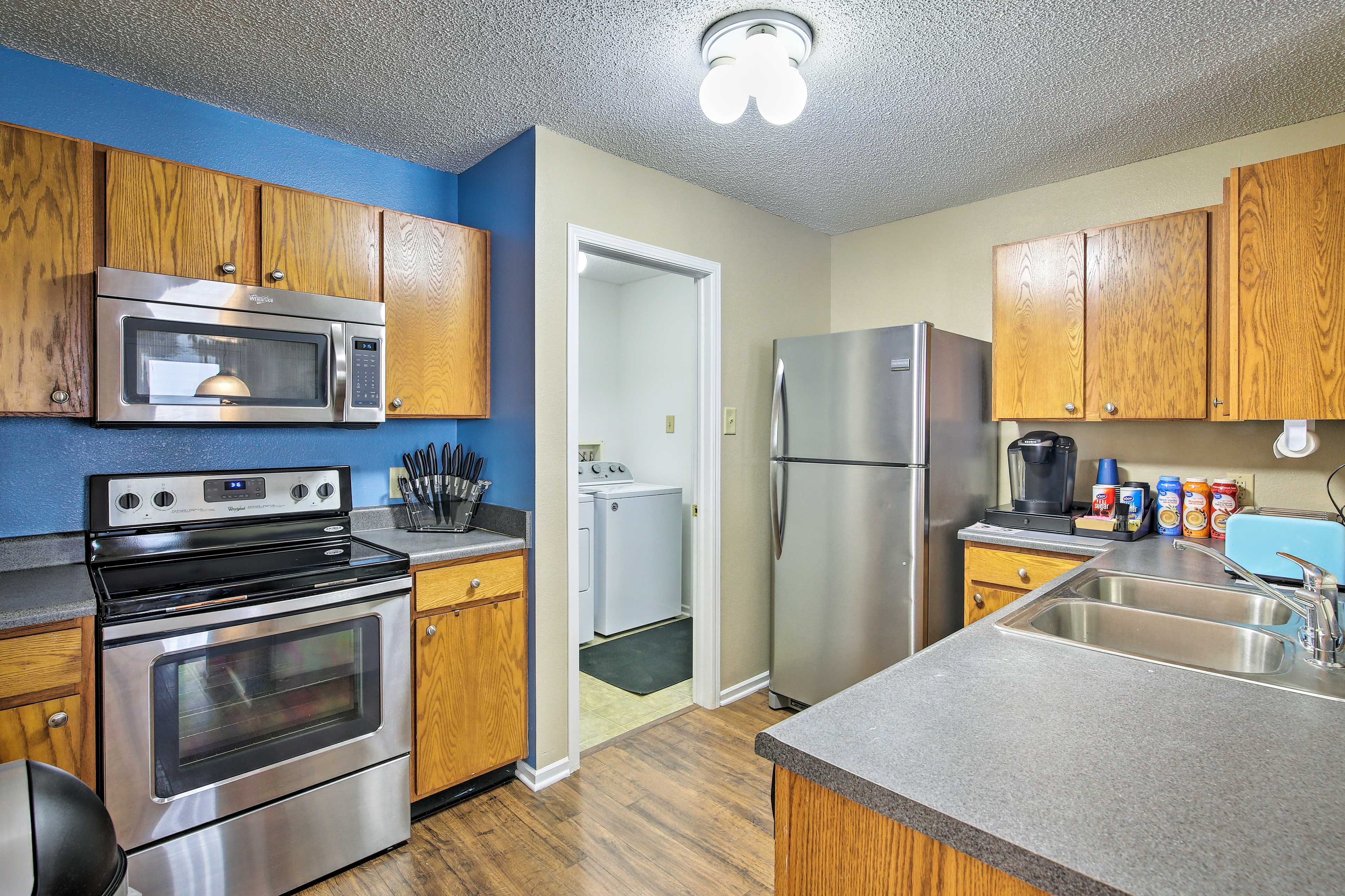 The kitchen is complete with stainless steel appliances.