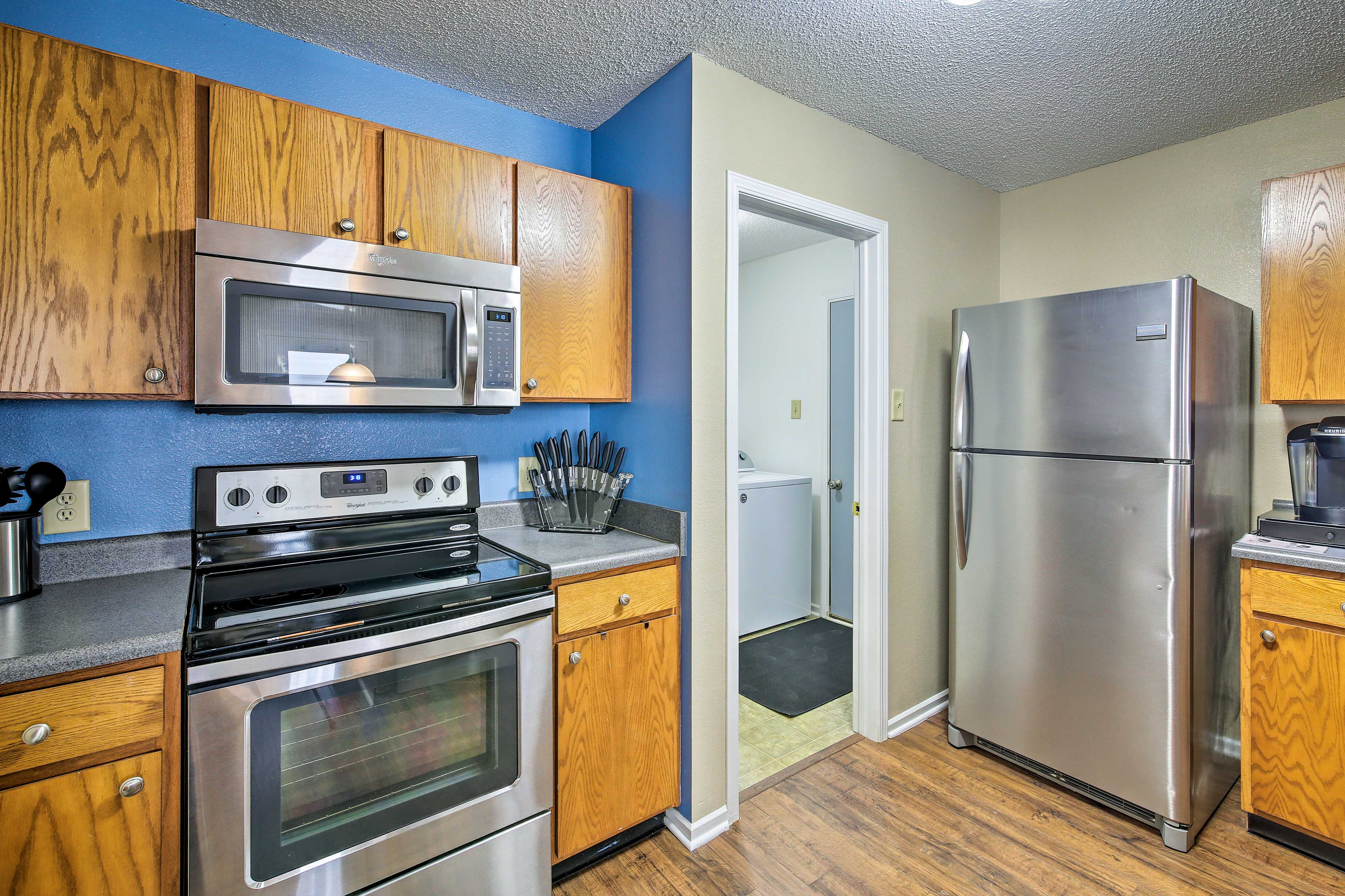 The in-unit laundry machines are located next to the kitchen.
