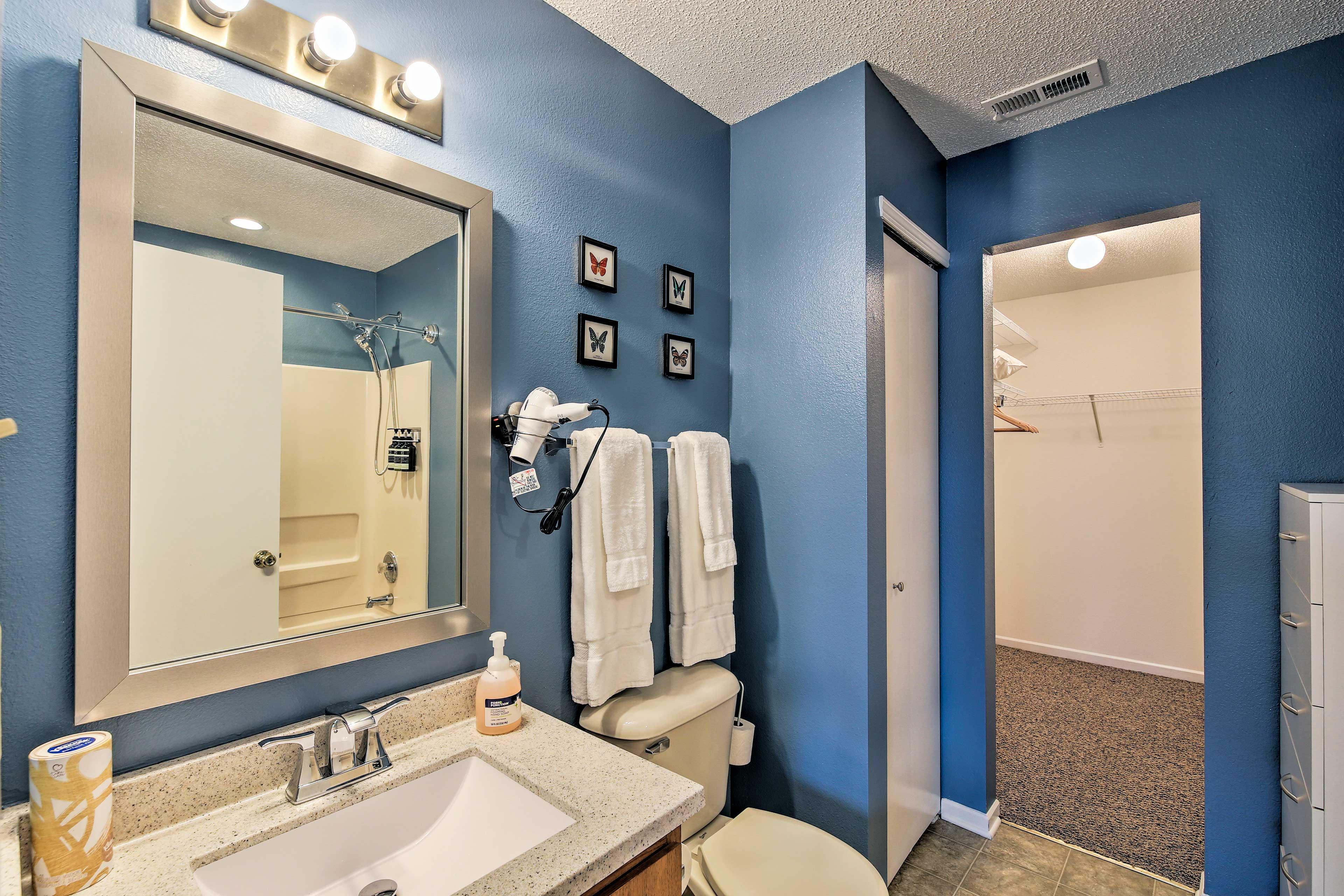 Enjoy the convenience of an en-suite bathroom and walk-in closet.