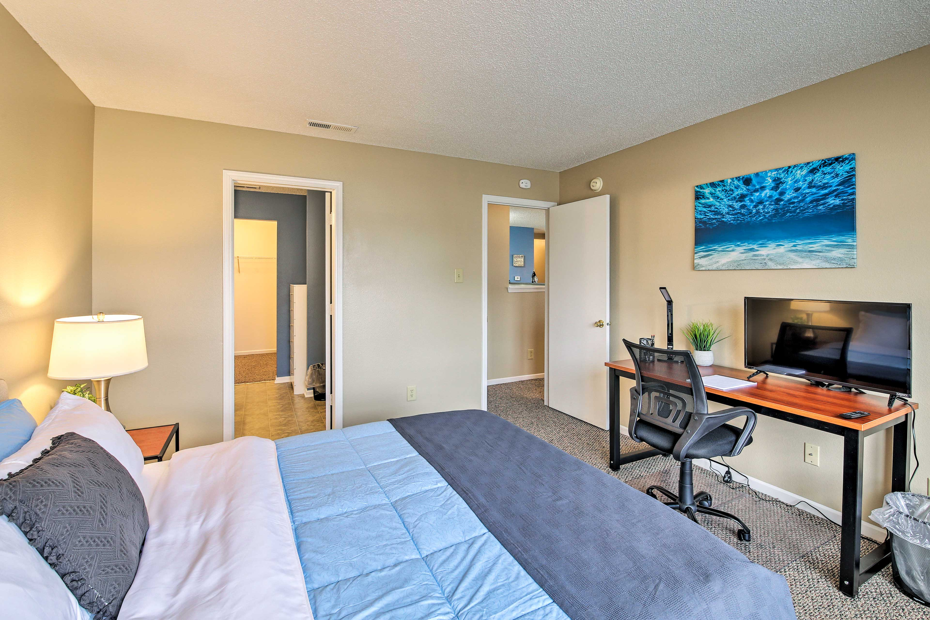 Watch a movie from the comfort of this queen bed.