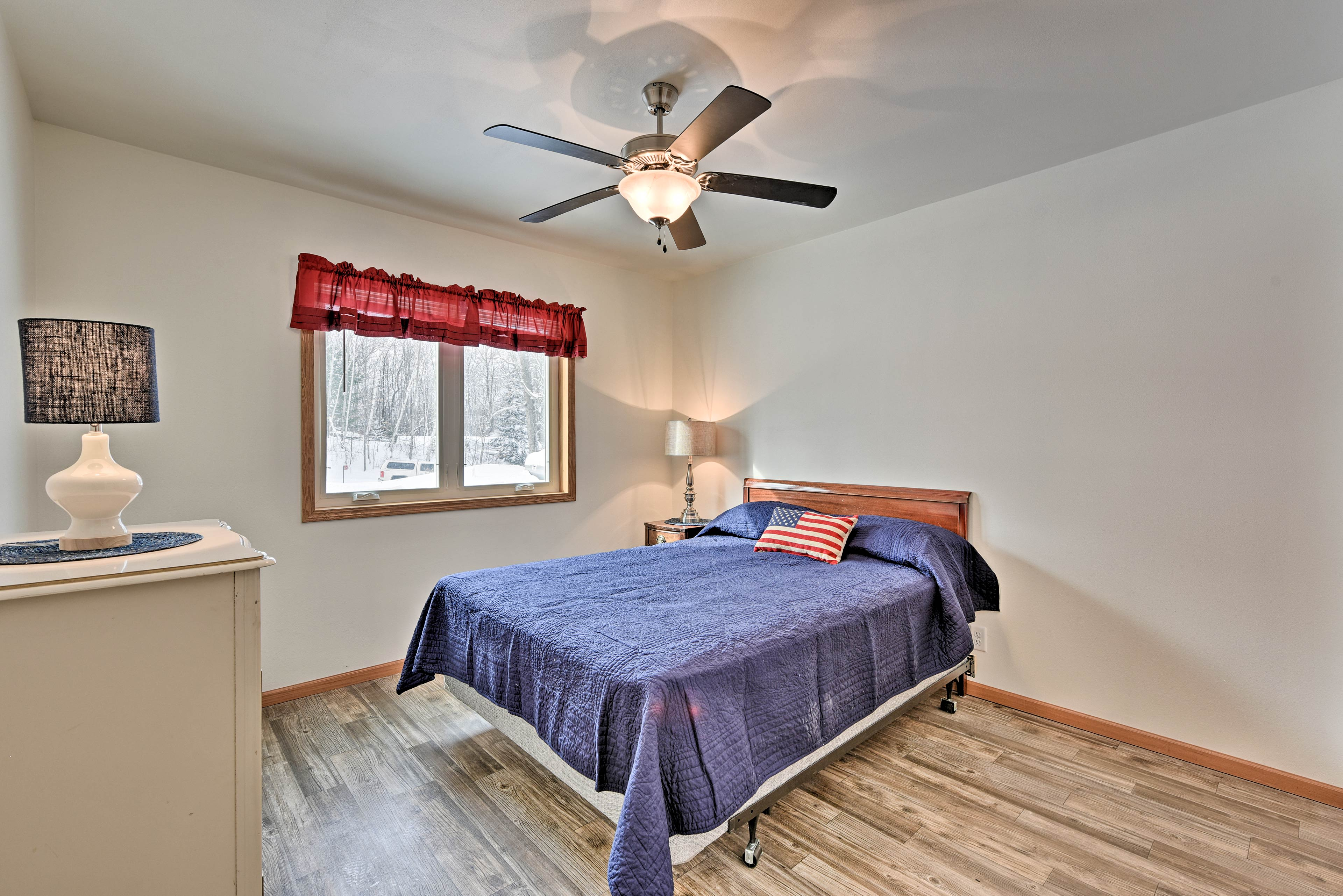 Another queen-sized bed is located in the third bedroom.