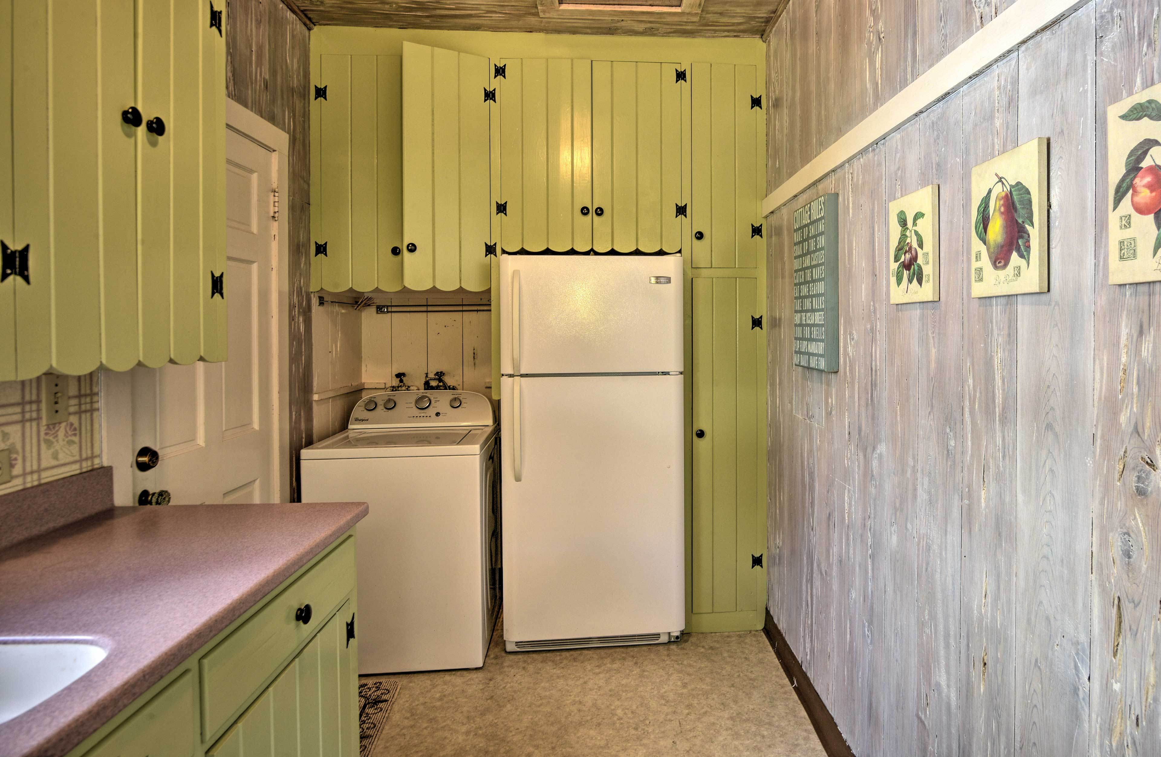 Cheery green cabinetry completes the kitchen.