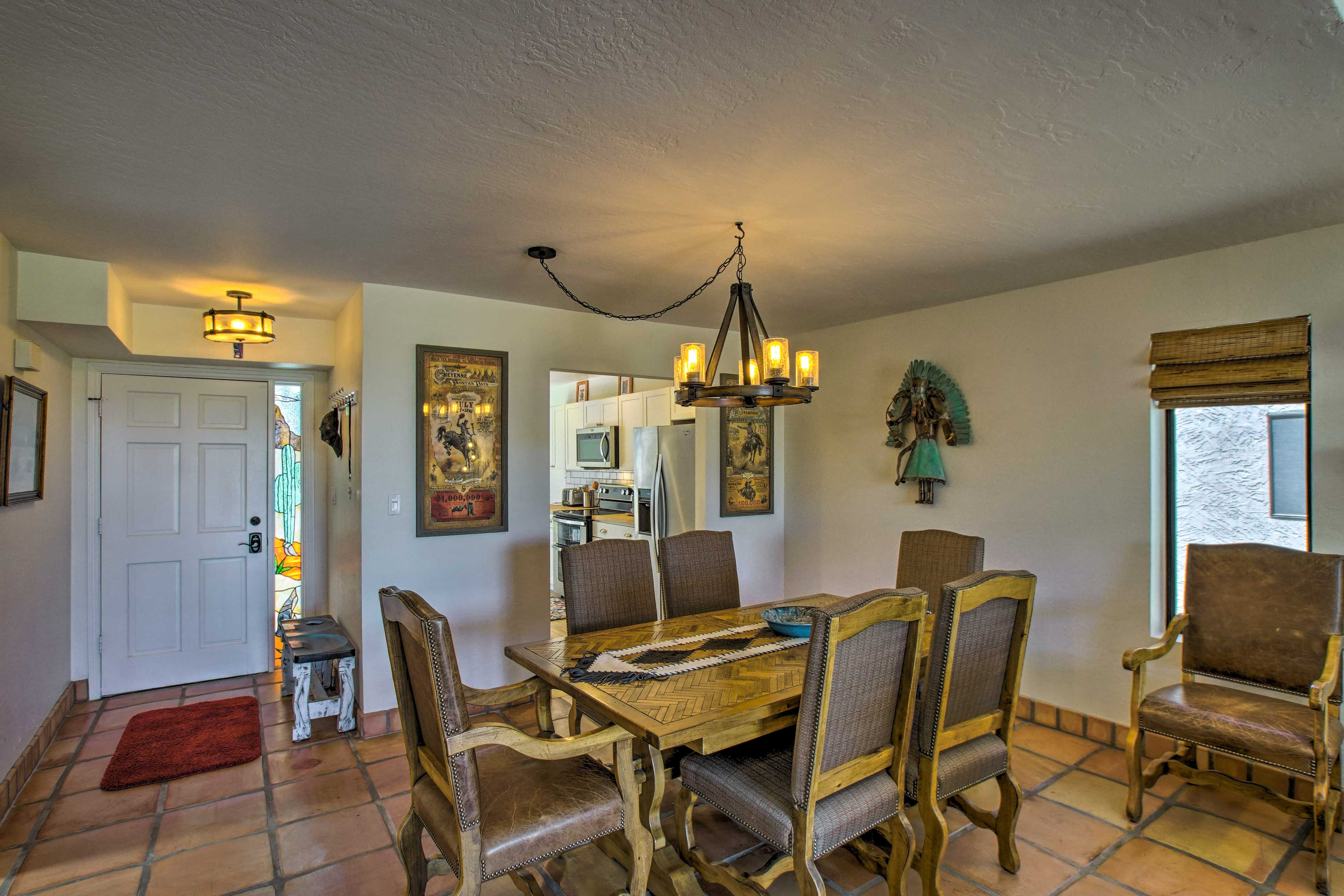 Savor home-cooked meals at the elegant 6-person dining table.