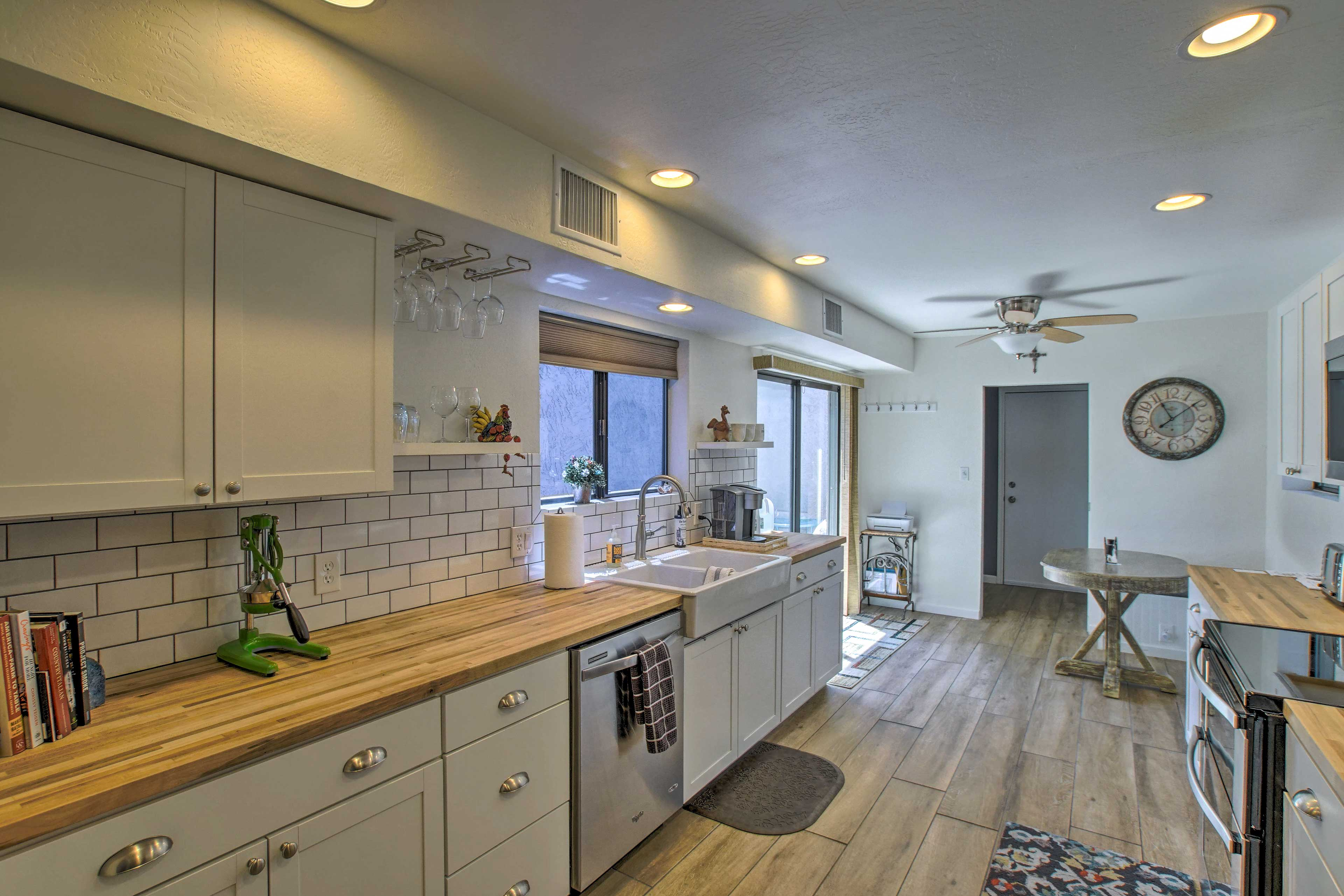 Butcher block counters and subway tiles elevate the kitchen.