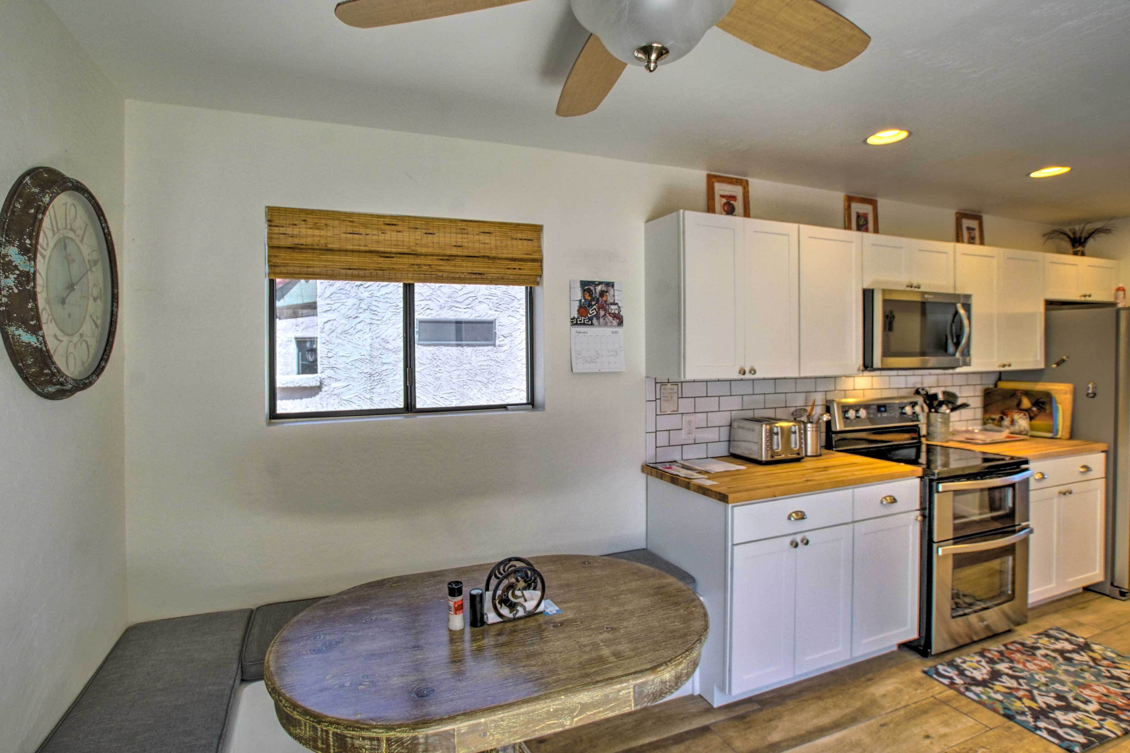 The kitchen is fully equipped and furnished with sleek contemporary style.
