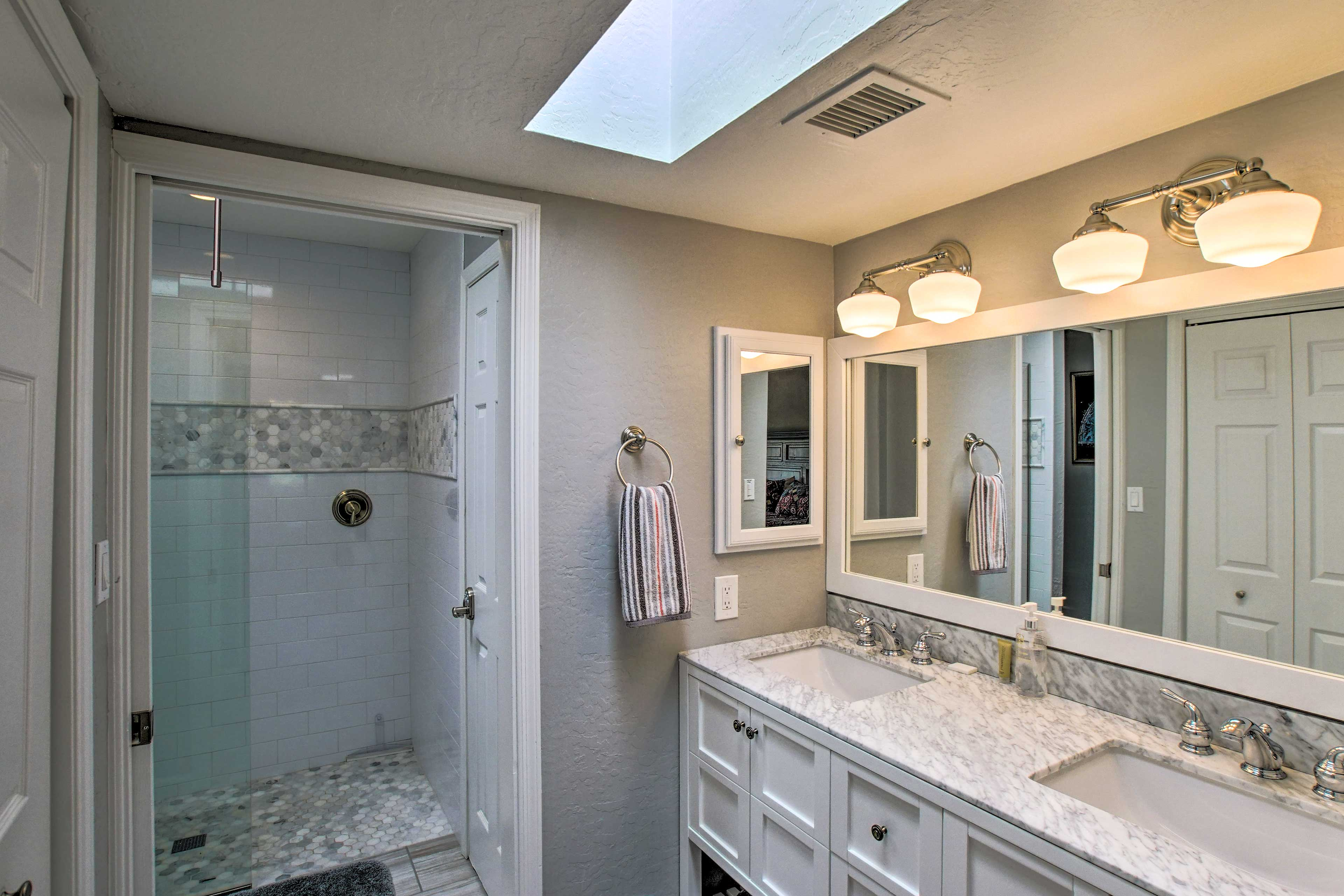 The second full bath hosts an elegant tiled shower and a double vanity.