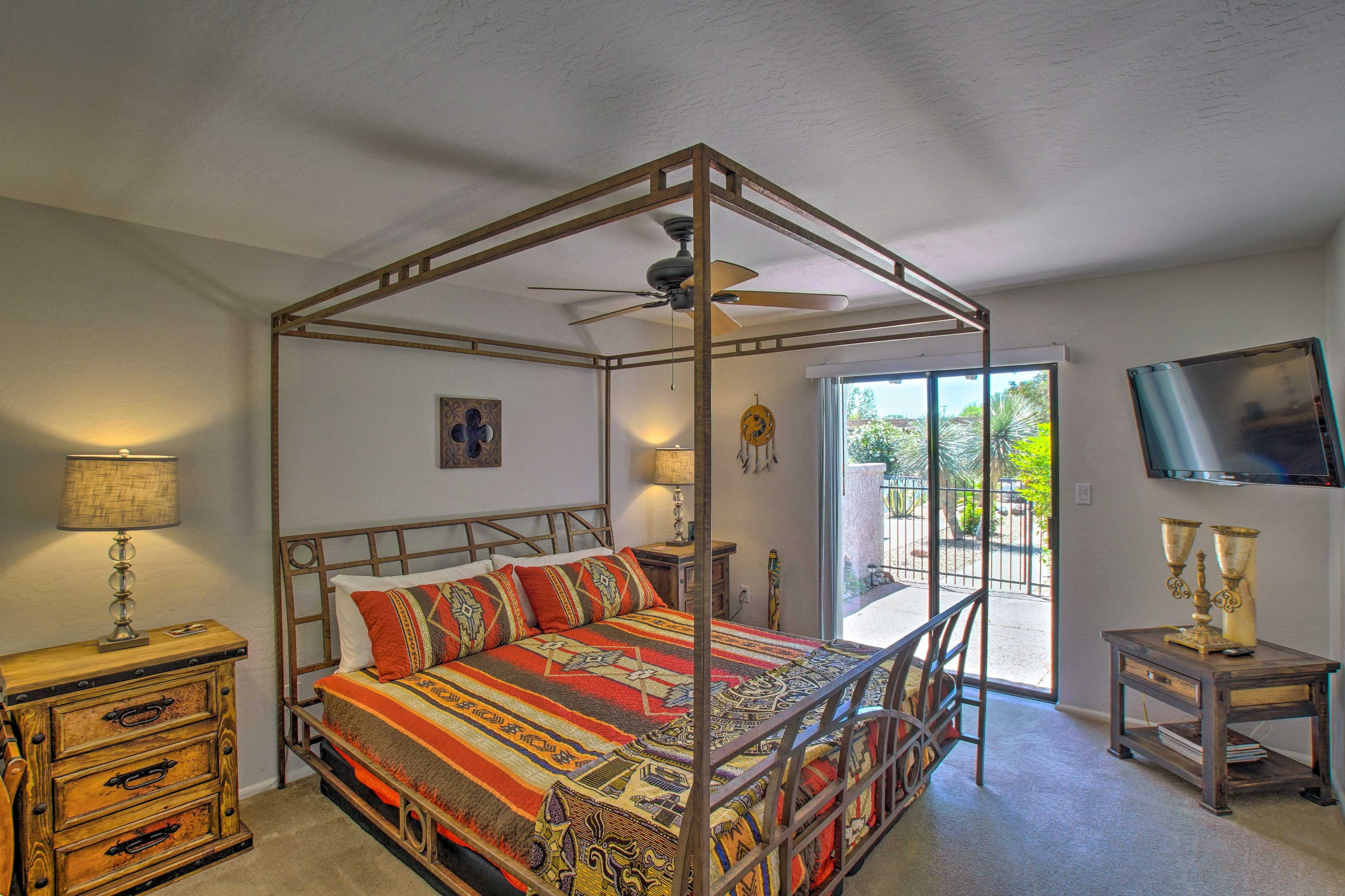 The first bedroom features a canopied California King bed and terrace access!
