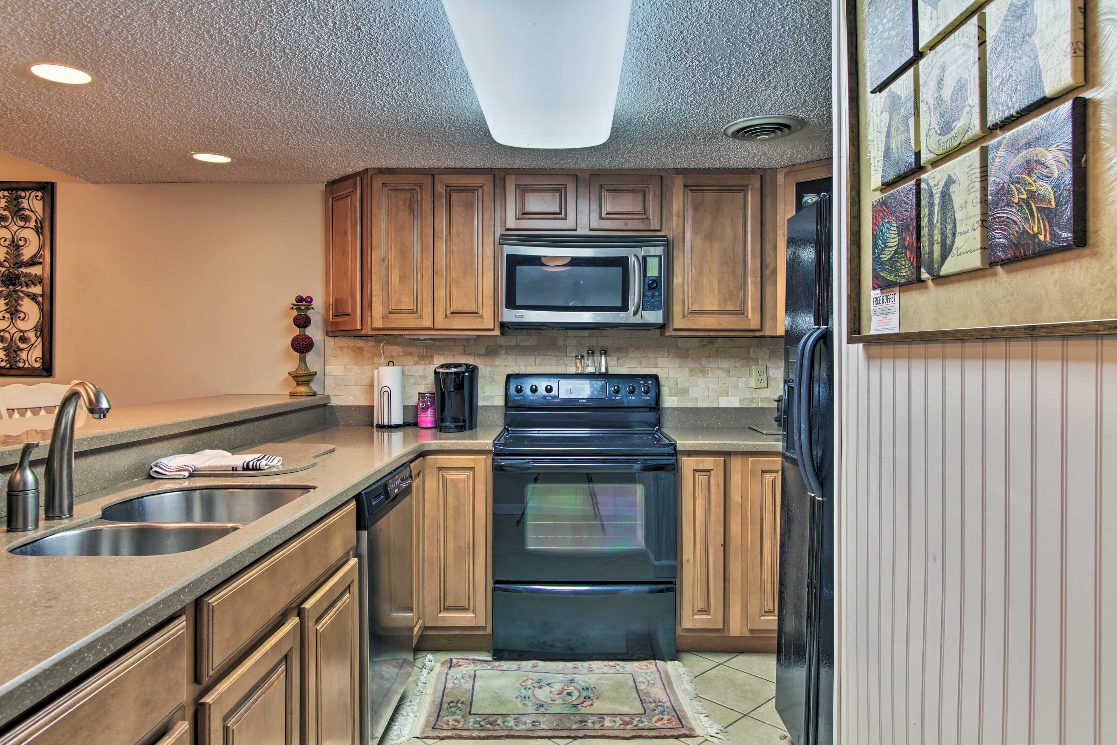 The fully equipped kitchen features modern appliances.