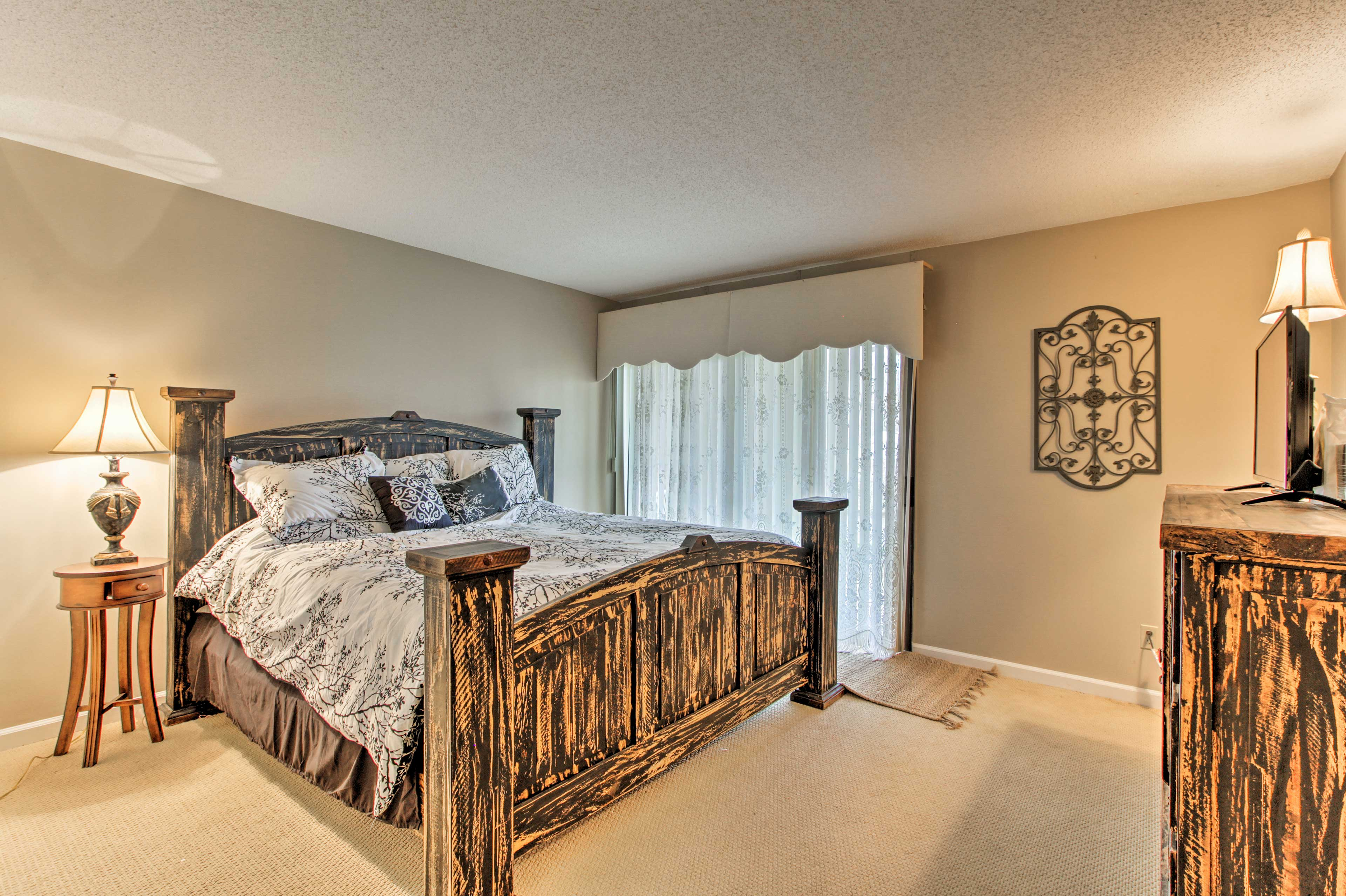 Rest easy on the king-sized bed in the master bedroom.