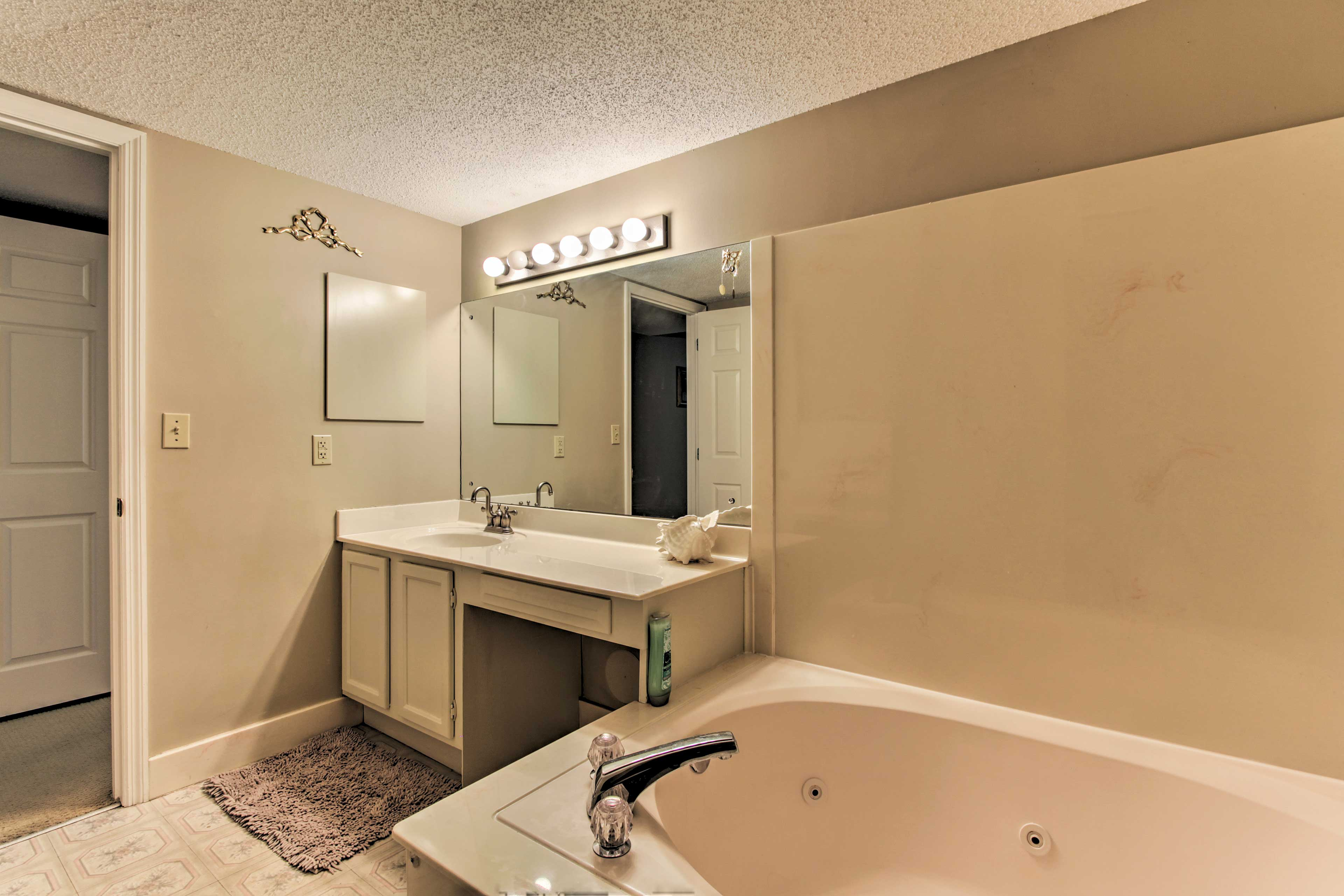 This bathroom offers a jetted tub.