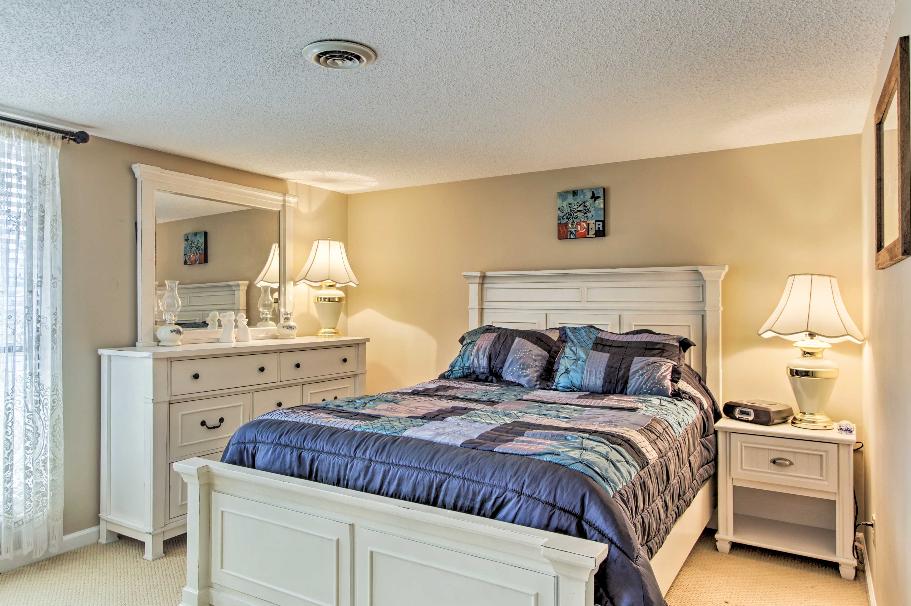 Two more guests can sleep on this queen bed.