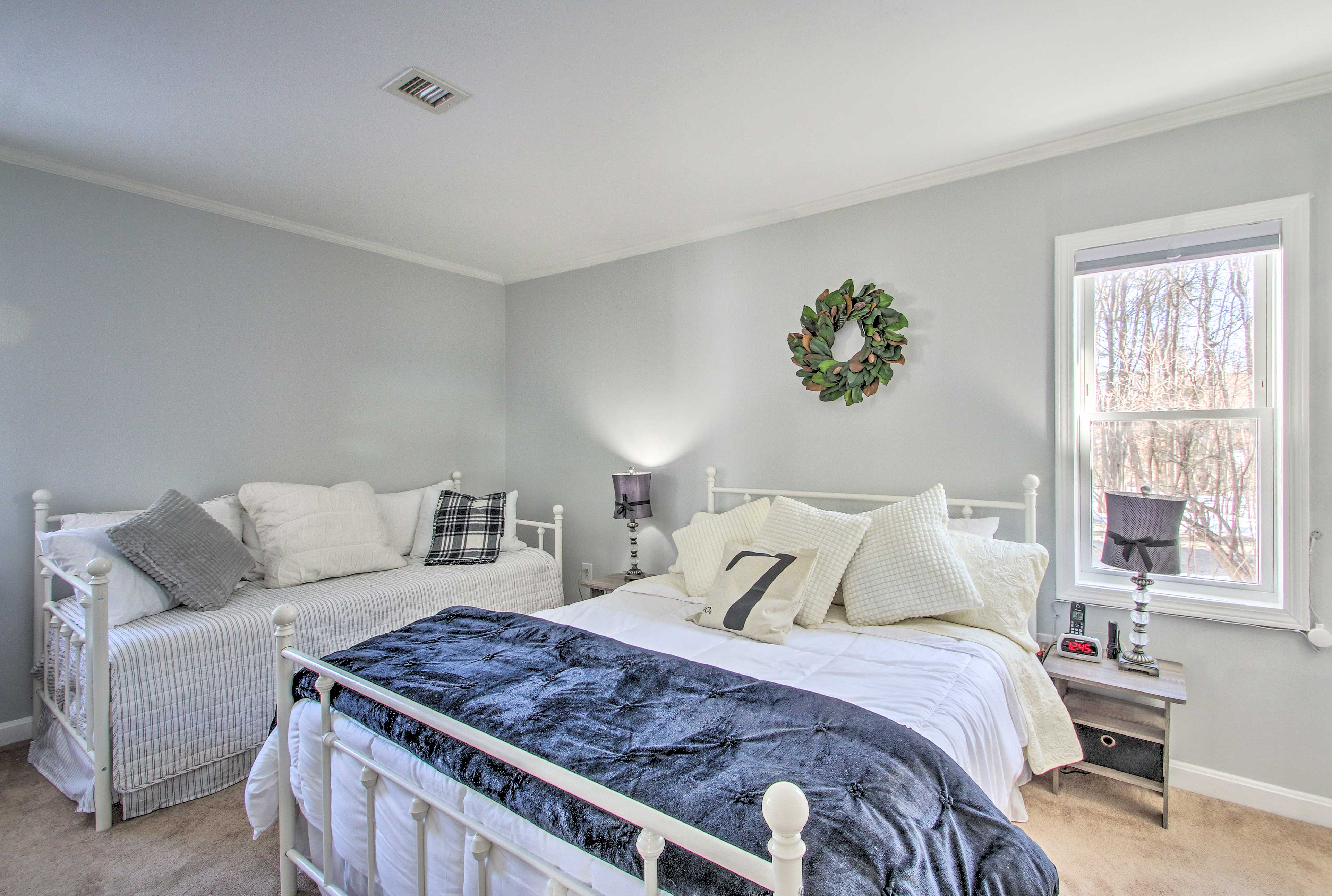 This lovely bedroom offers a queen bed and twin bed with a twin trundle bed.