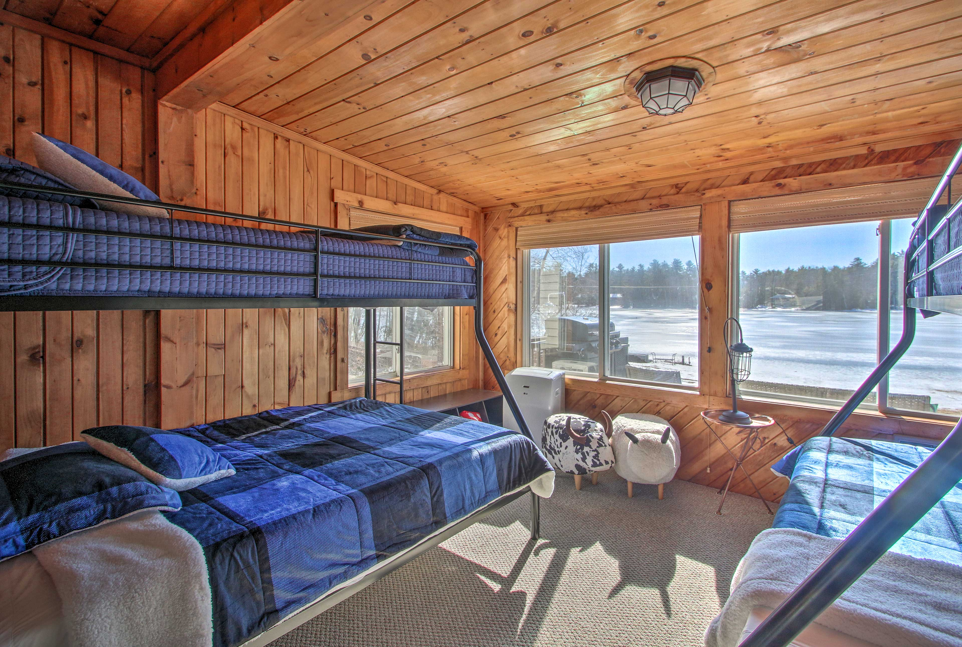 Kids will love sharing this lake-view bunk room!