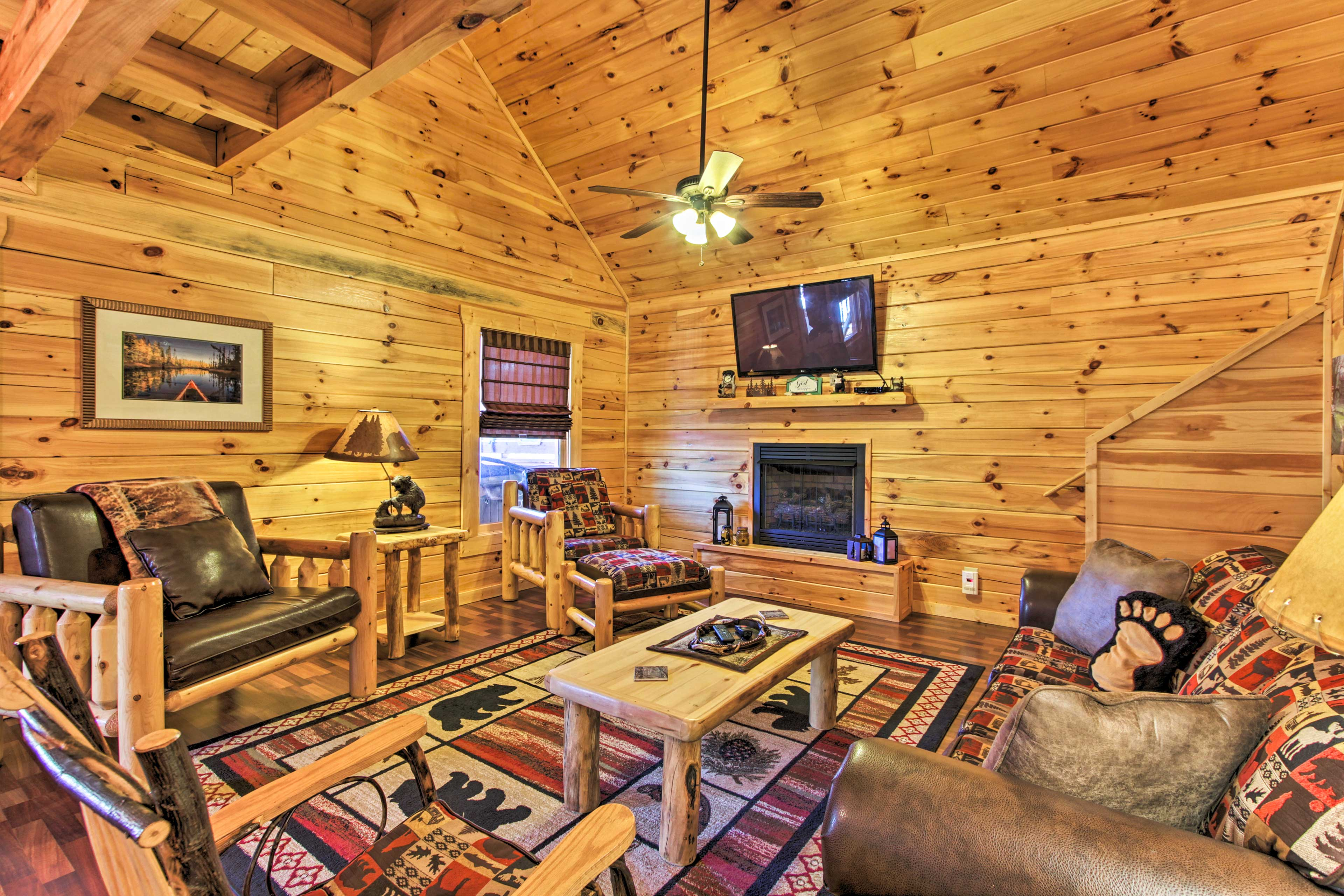 Indoors, mountain-themed decor accentuates the log cabin living space.
