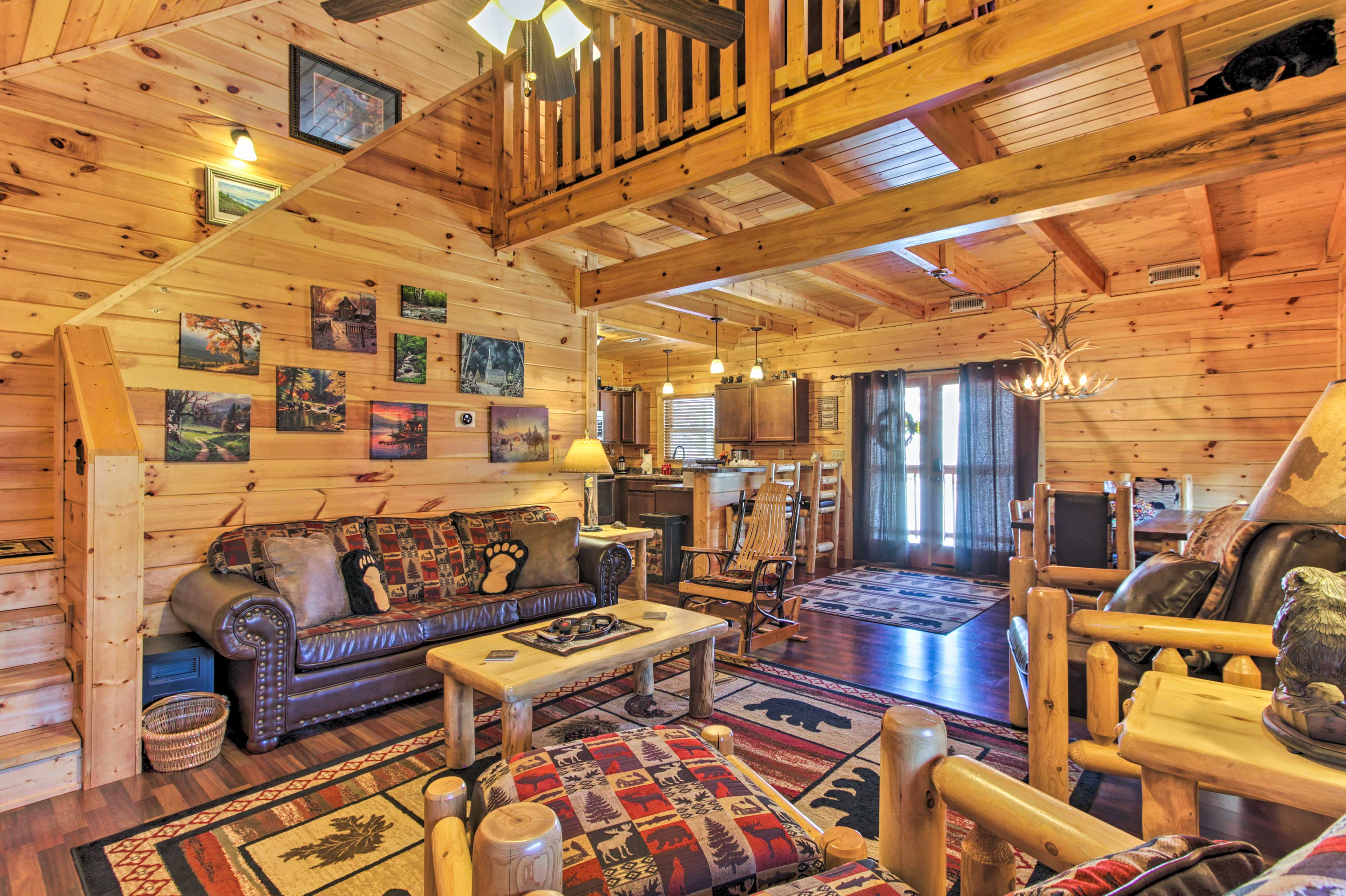 Rustic decor and portraits of scenic landscapes highlight the living room.