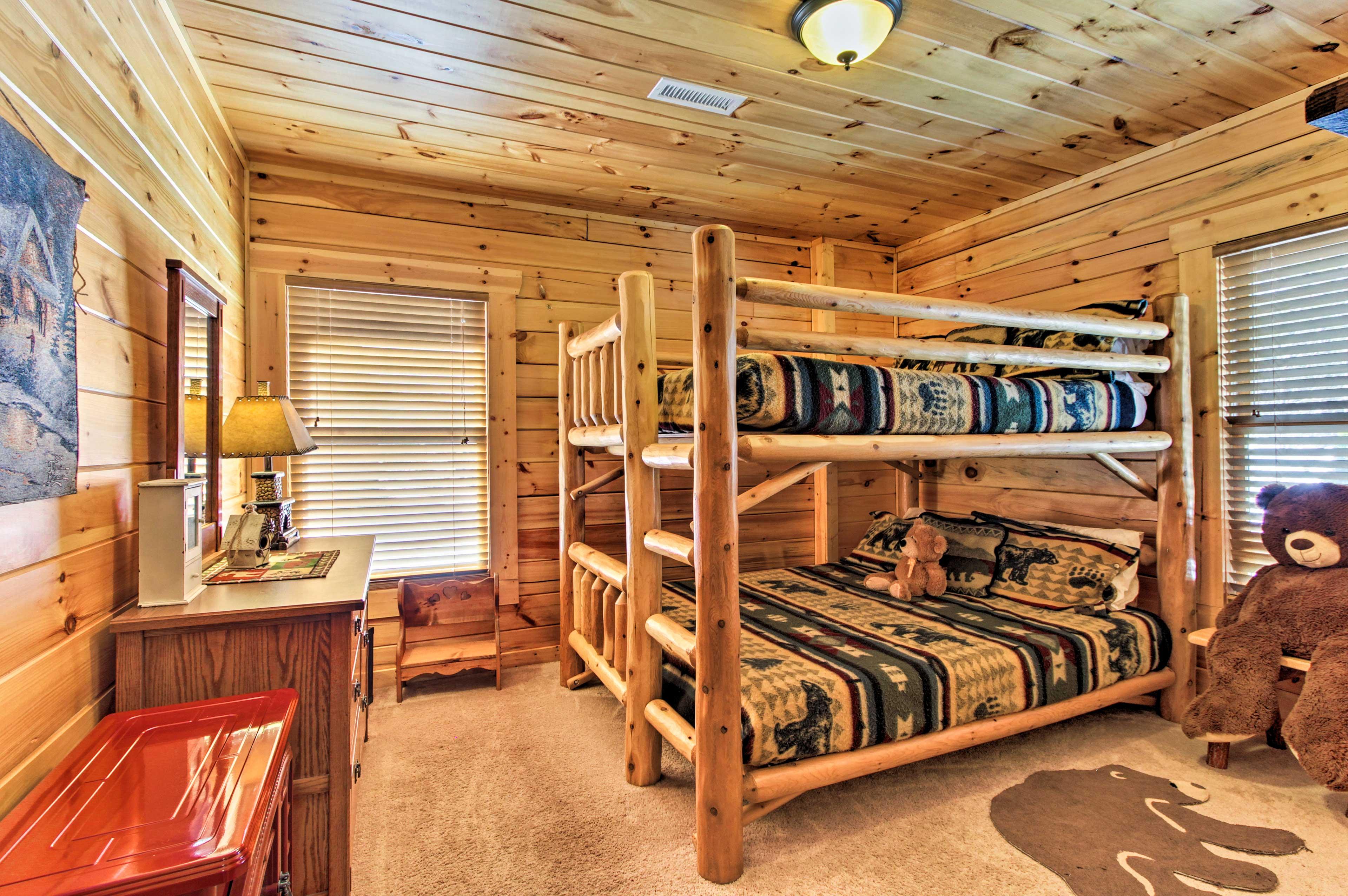 Queen-over-queen bunk beds can keep 4 cozy in this comfortable bedroom!