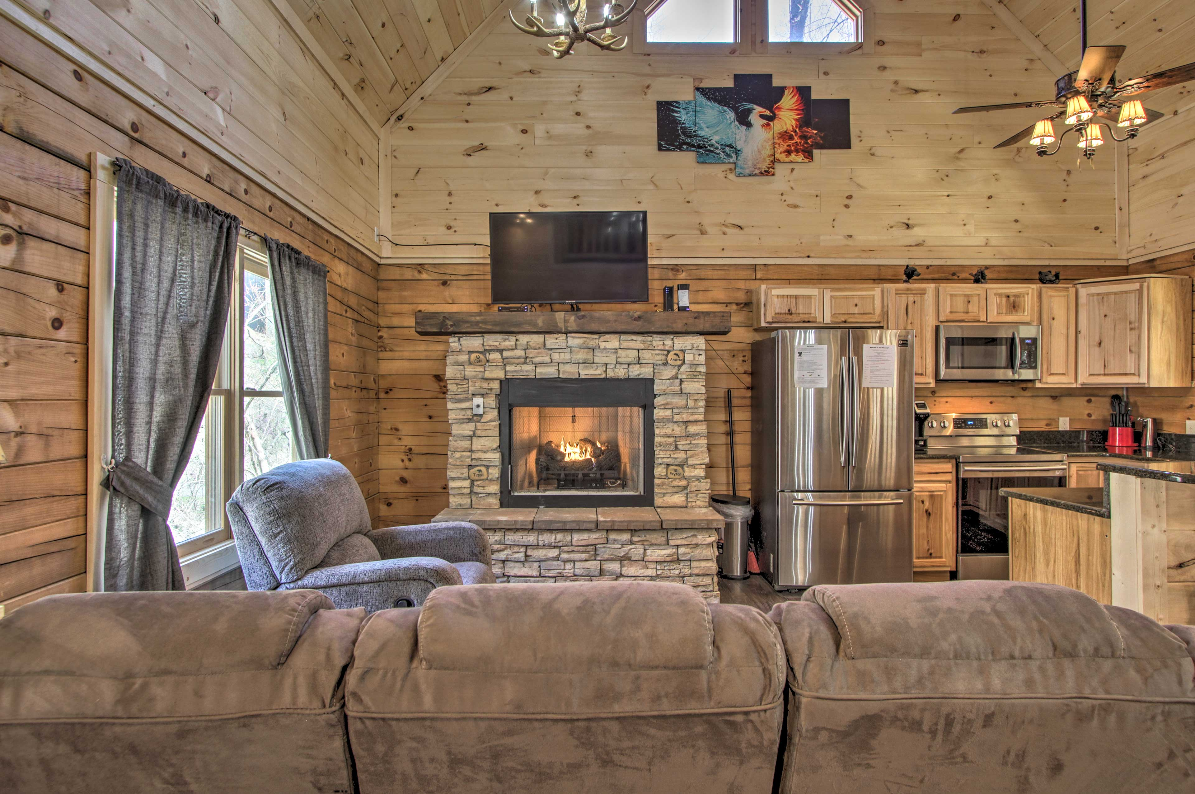 Don't forget to start up the fireplace to warm up in the living room.