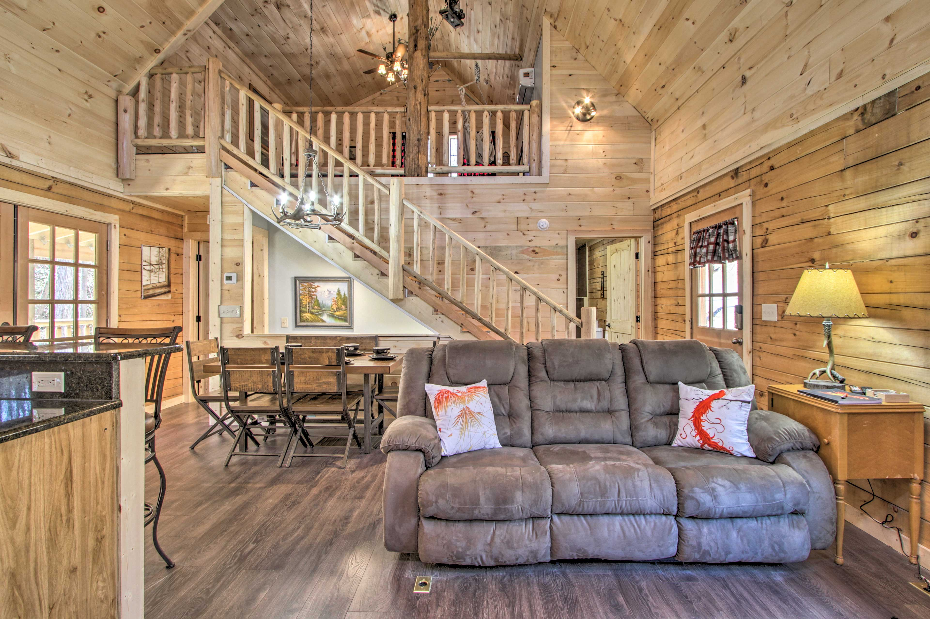 Relish vaulted ceilings, wood-adorned walls and floors, and a loft high above!