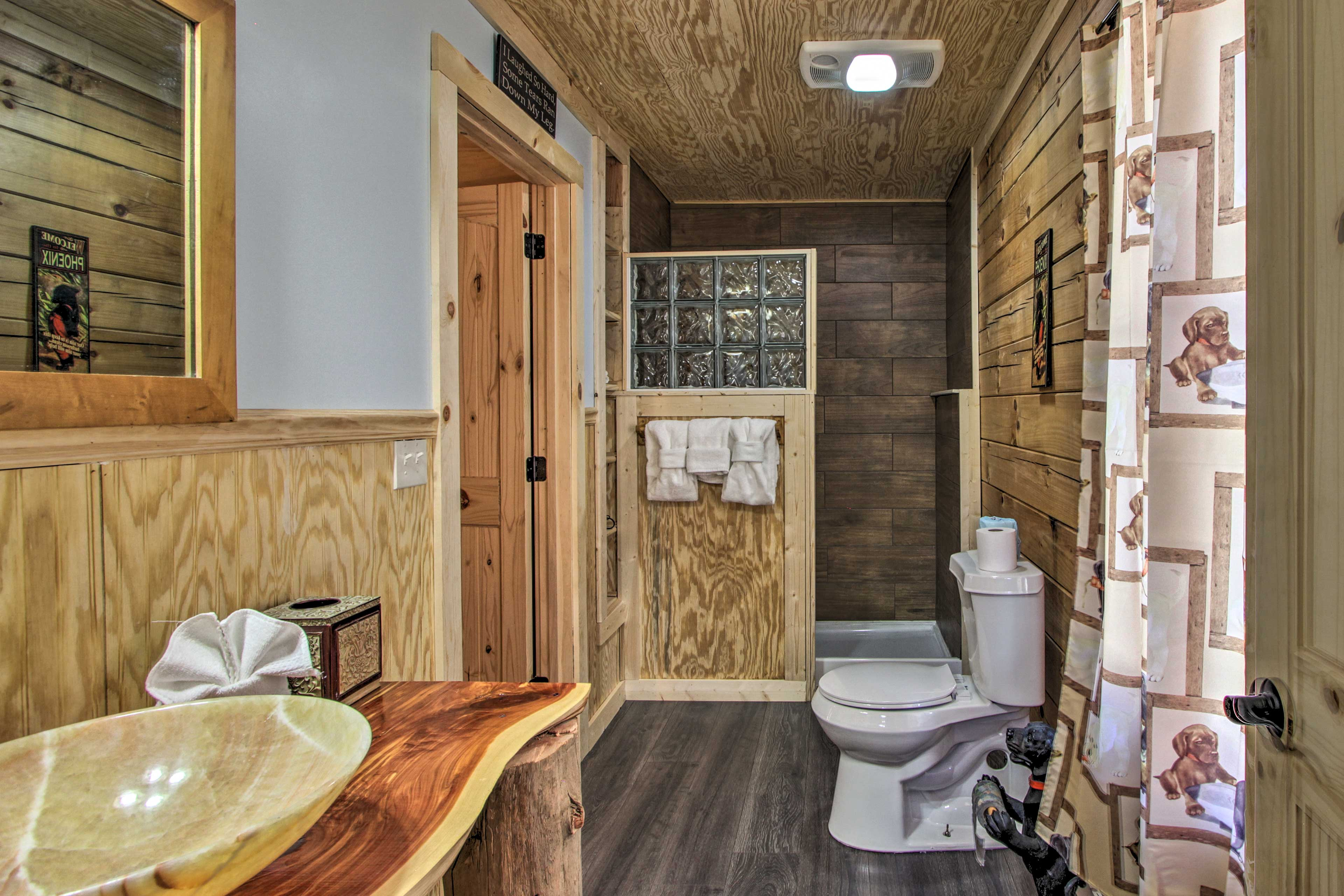 Enjoy an en-suite bathroom with a glass block adorned shower.
